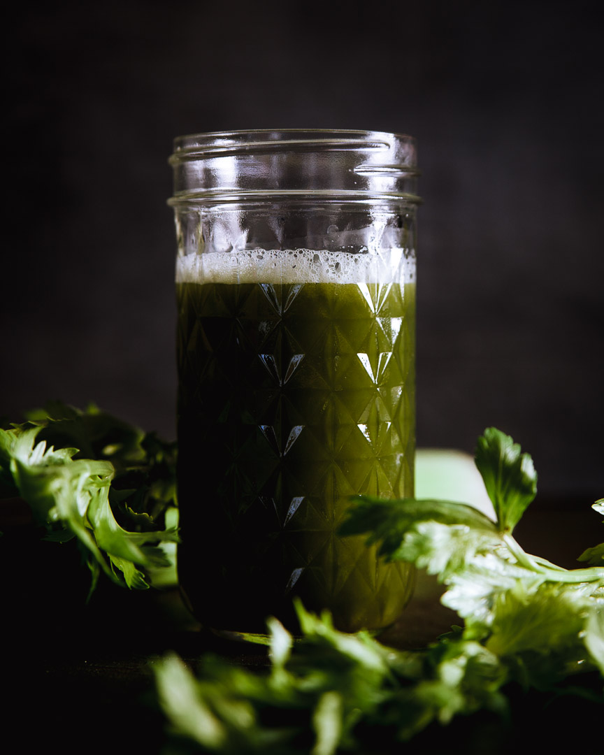 celery juice shot with moody background and light. Sarah Ehlinger / Brand Spanking You Brand Photography