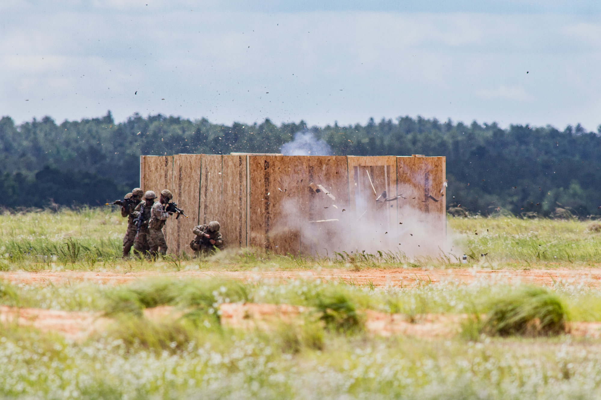 Paratroopers from the 82nd Airborne Division demonstrate a breaching charge on a walled compound as part the Airborne Review at Sicily Drop Zone at Fort Bragg, N.C., on Thursday, May 25, 2017.