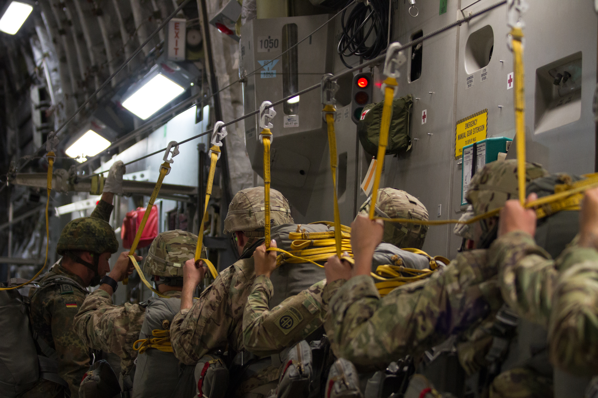 Paratroopers with the 82nd Airborne Division walk towards the jump door during a training jump at Fort Bragg, N.C. on July 26, 2017.