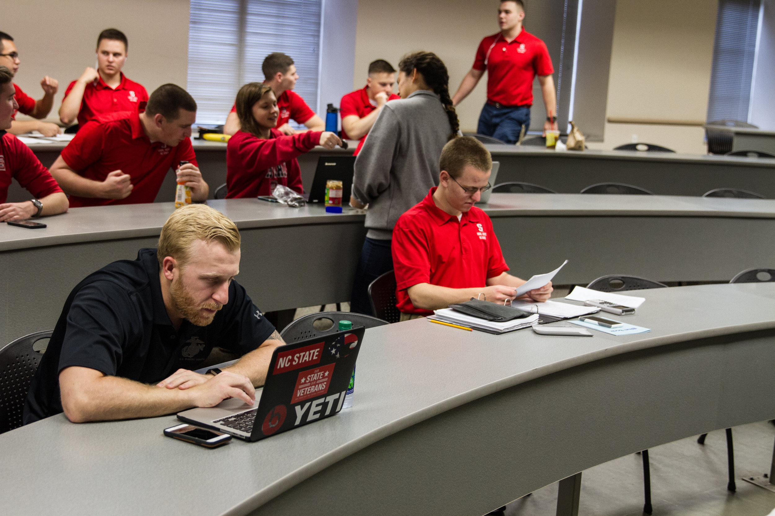 "Fontenot reads up on his notes before the start of his class. The majority of the rest of the students in the class are ROTC cadets (the students in red shirts), who will eventually be military officers. ""I'm 26 and I'm going to school with people who are eight years younger than me. I see that generation gap everyday. The ROTCs, 'The Future Defenders of America' all think their shit don't stink."""