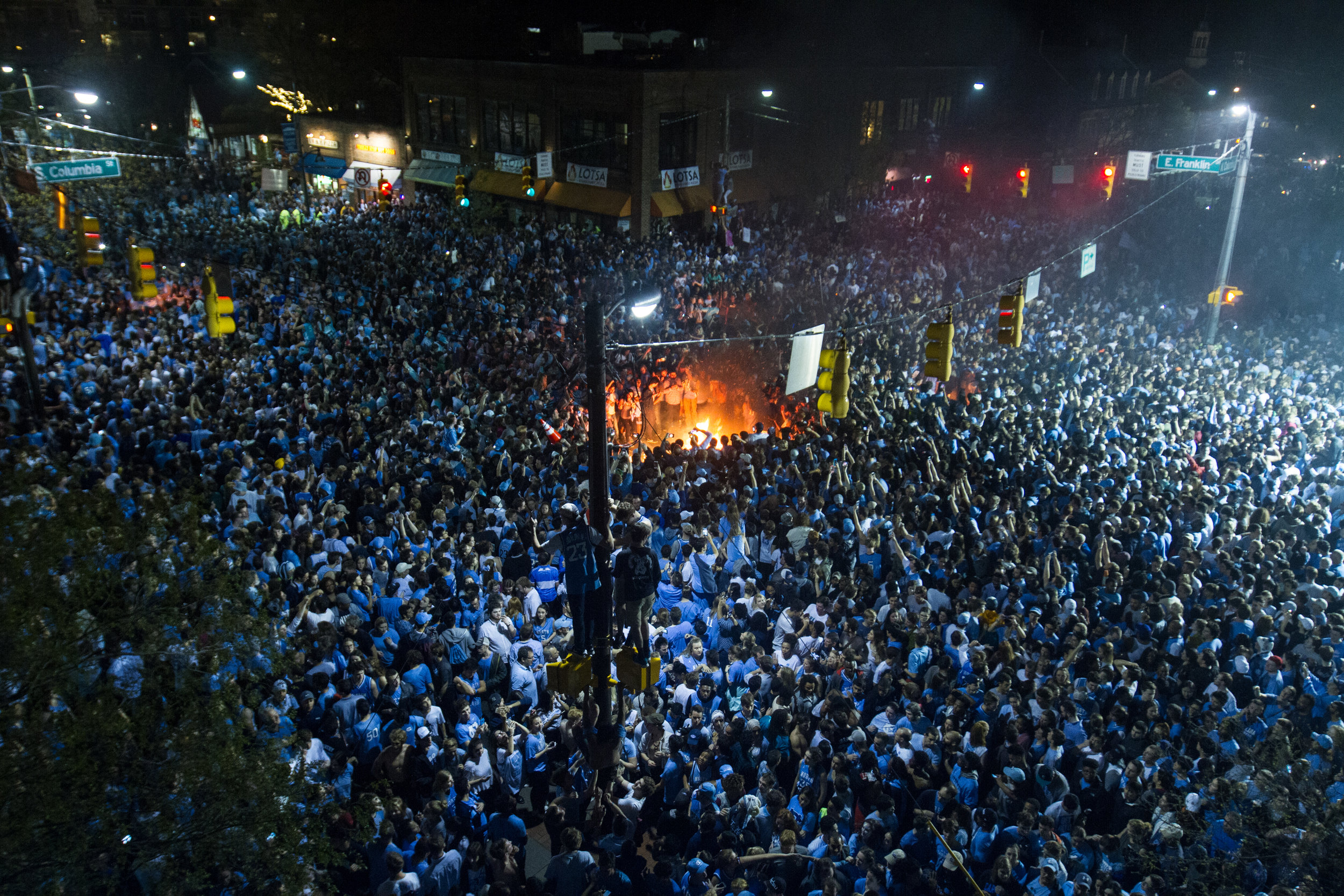 Thousands of Carolina fans storm Franklin Street after the North Carolina Tar Heels defeated the Gonzaga Bulldogs 71 to 65 on April 3, 2017.