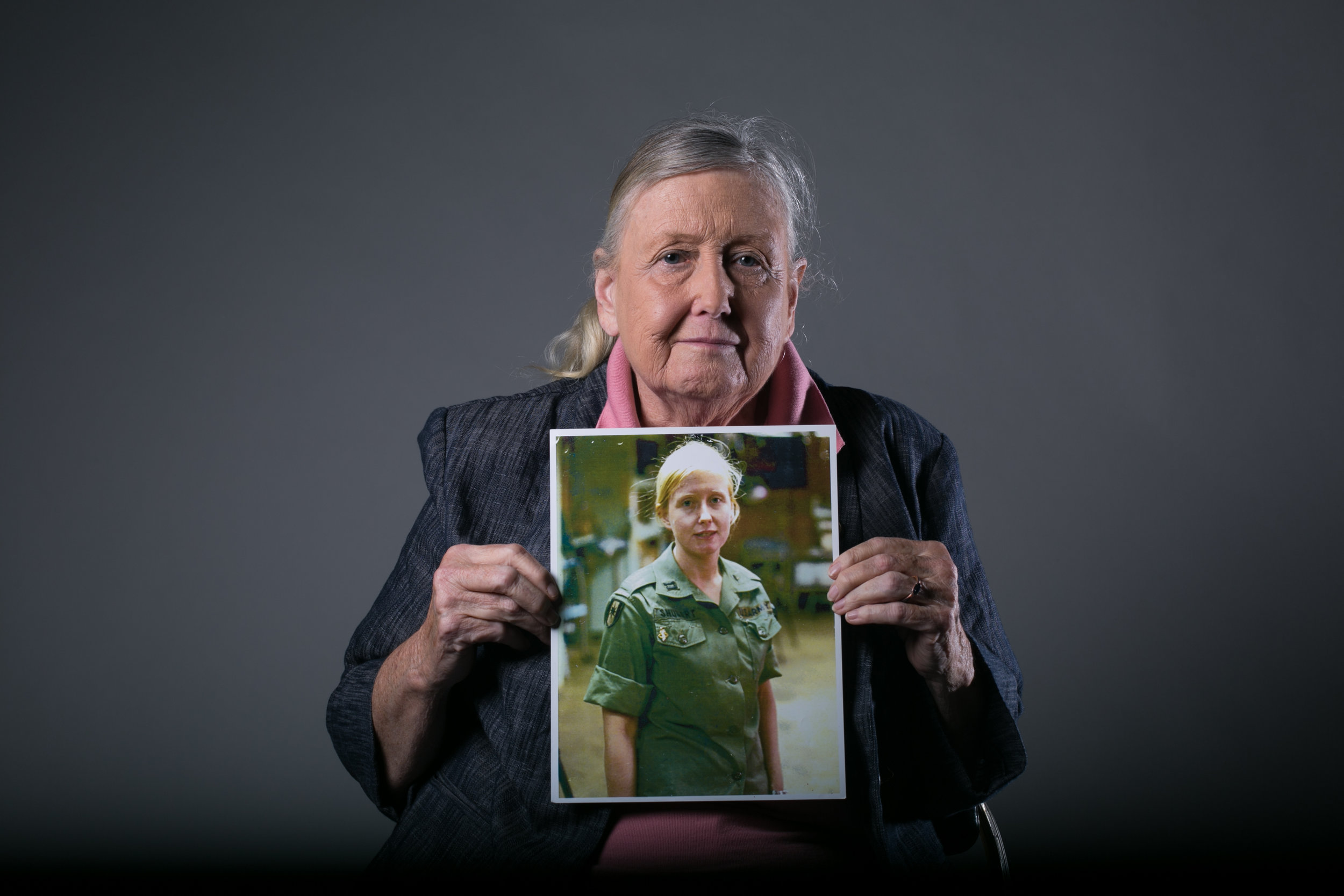 Mary Ellen Shugart of the Army Nurse Corps, holds a picture of herself from her time as a nurse in Vietnam.