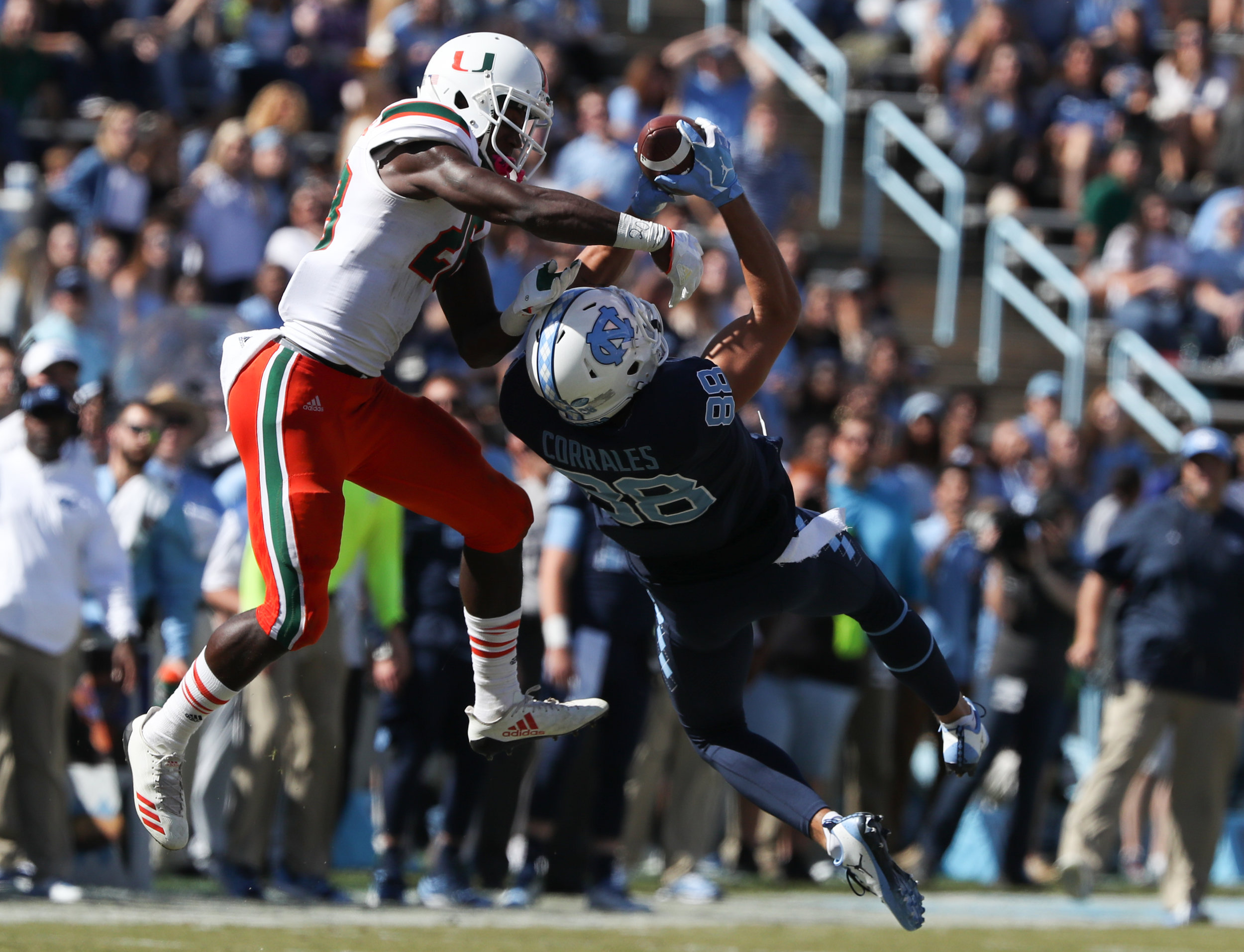 UNC's Beau Corrales, right, grabs a pass in front of Miami's Michael Jackson during Saturday's game at Kenan Memorial Stadium in Chapel Hill, NC on October 28, 2017. The Hurricanes beat the Tar Heels 24 to 19.