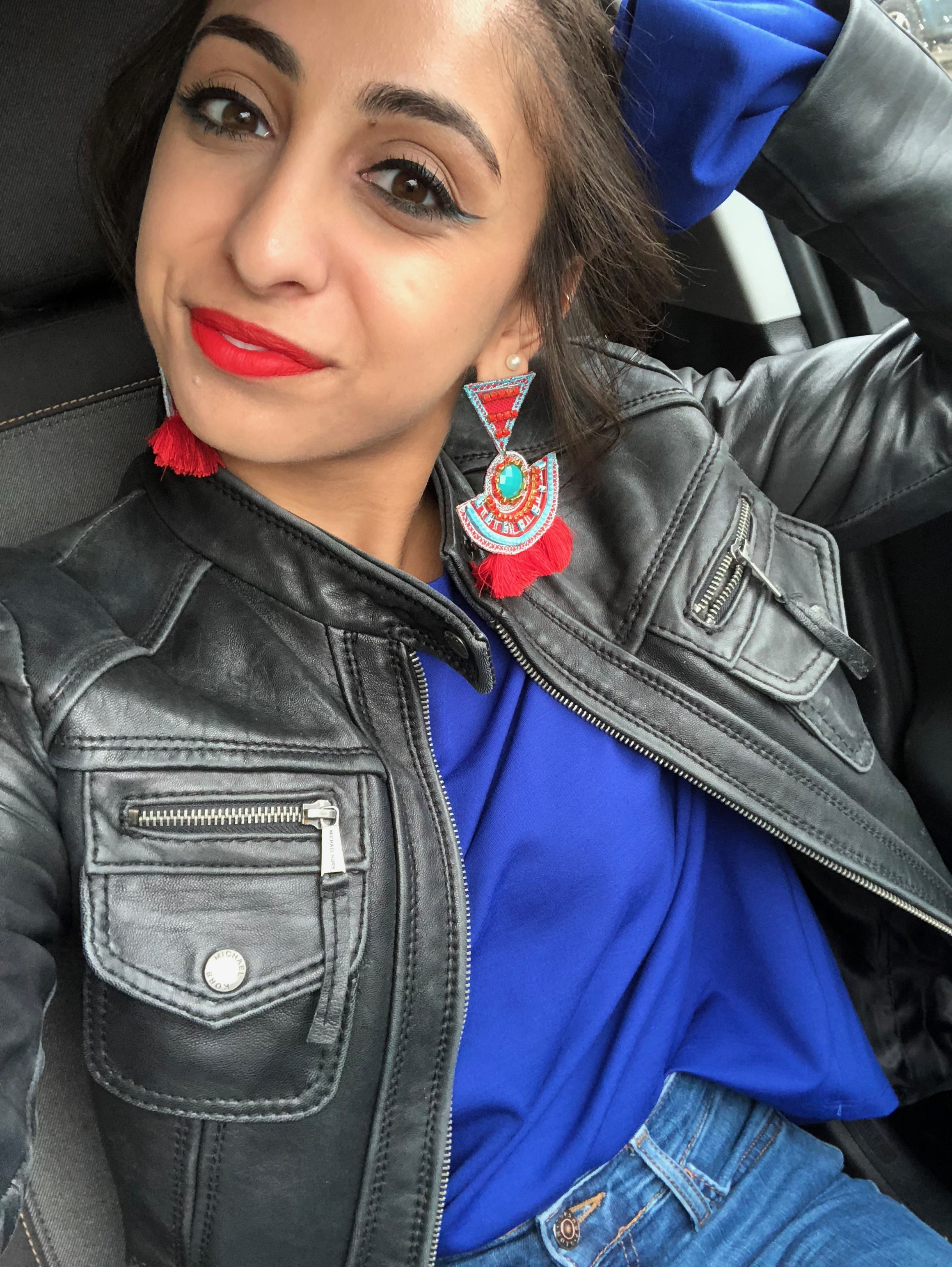 This fun and colorful look is one I love for days that I feel like playing up my makeup. When you look at just the outfit, it's all pretty simple, but what makes it work are all of the little details, such as the sleeves on the top which stick out of the leather jacket, or the earrings that match the makeup and top. The leather jacket here tones the boldness down. The top is from Nordstrom Rack, jeans from Topshop, earrings from TjMaxx, and booties from Steve Madden.