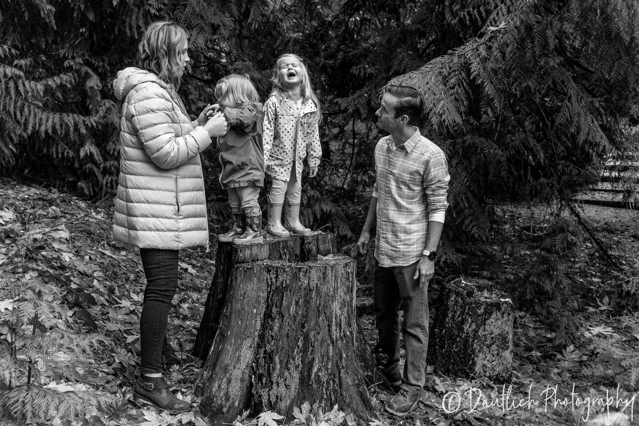 The Ringer family stops at a log during our walk in the woods behind their new home. Delaney has a little tantrum for just a moment while dad stares as her.