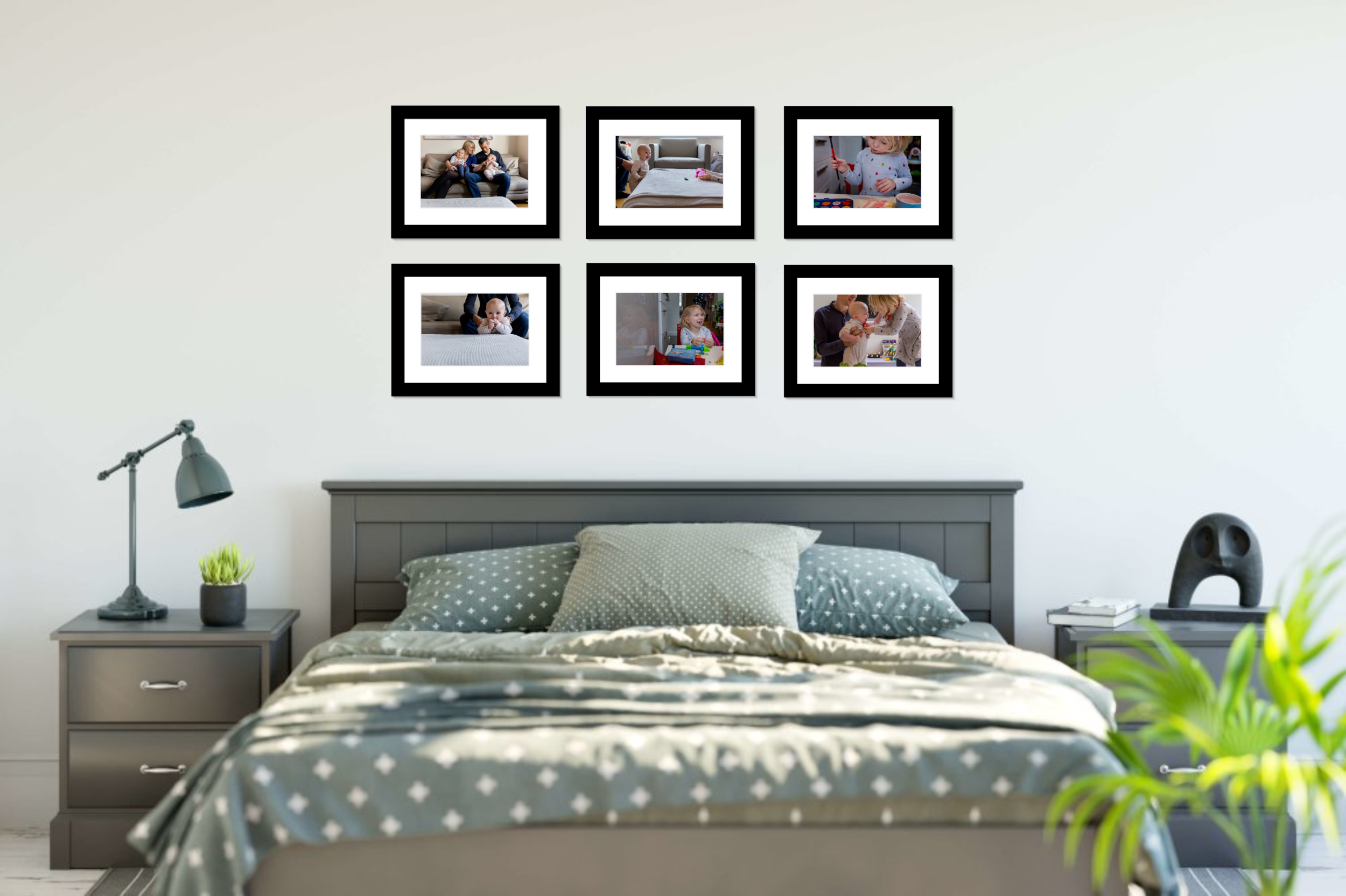 Sample bedroom with framed wall art display of photos from documentary family photo session.