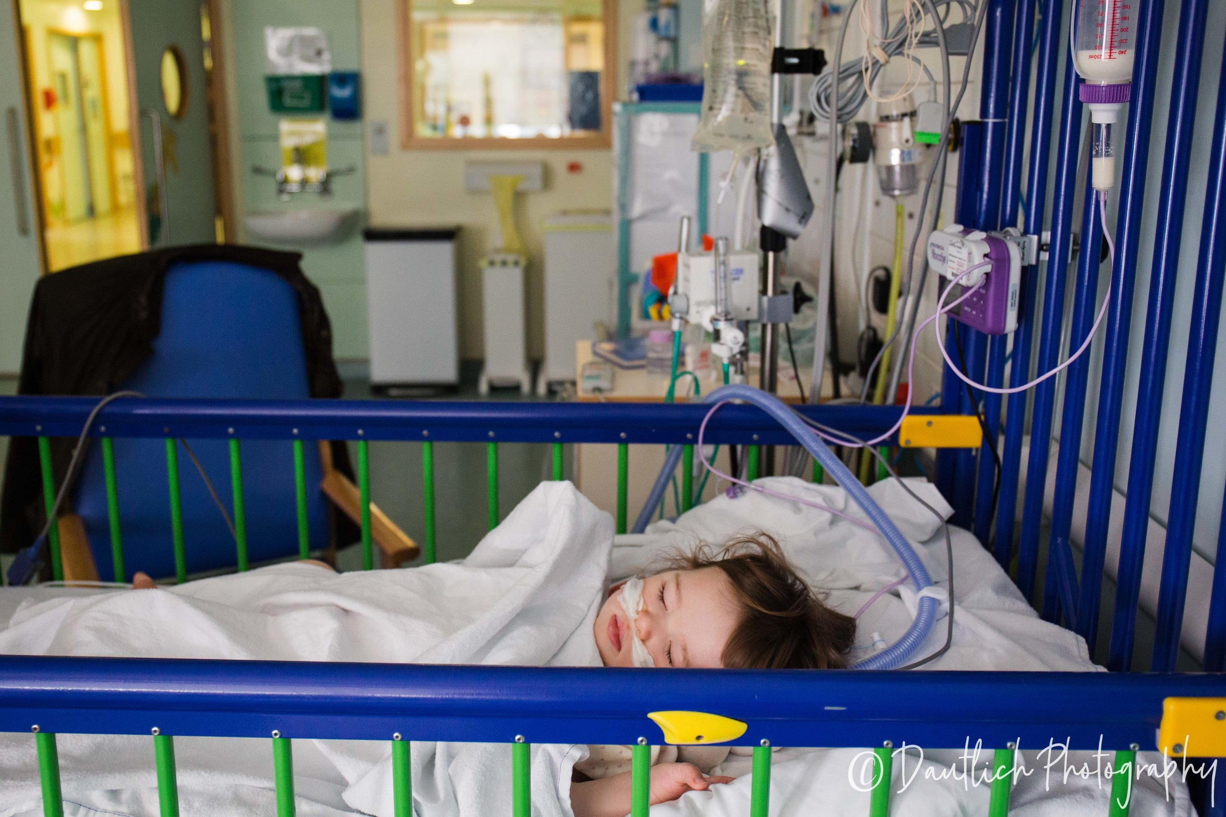 Holding Ben in hospital bed