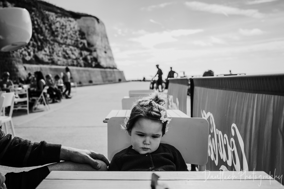 """Hazel having a pout at Molly's Cafe at Rottingdean Beach. Because you can't have a """"holiday"""" with toddler without a few temper tantrums."""
