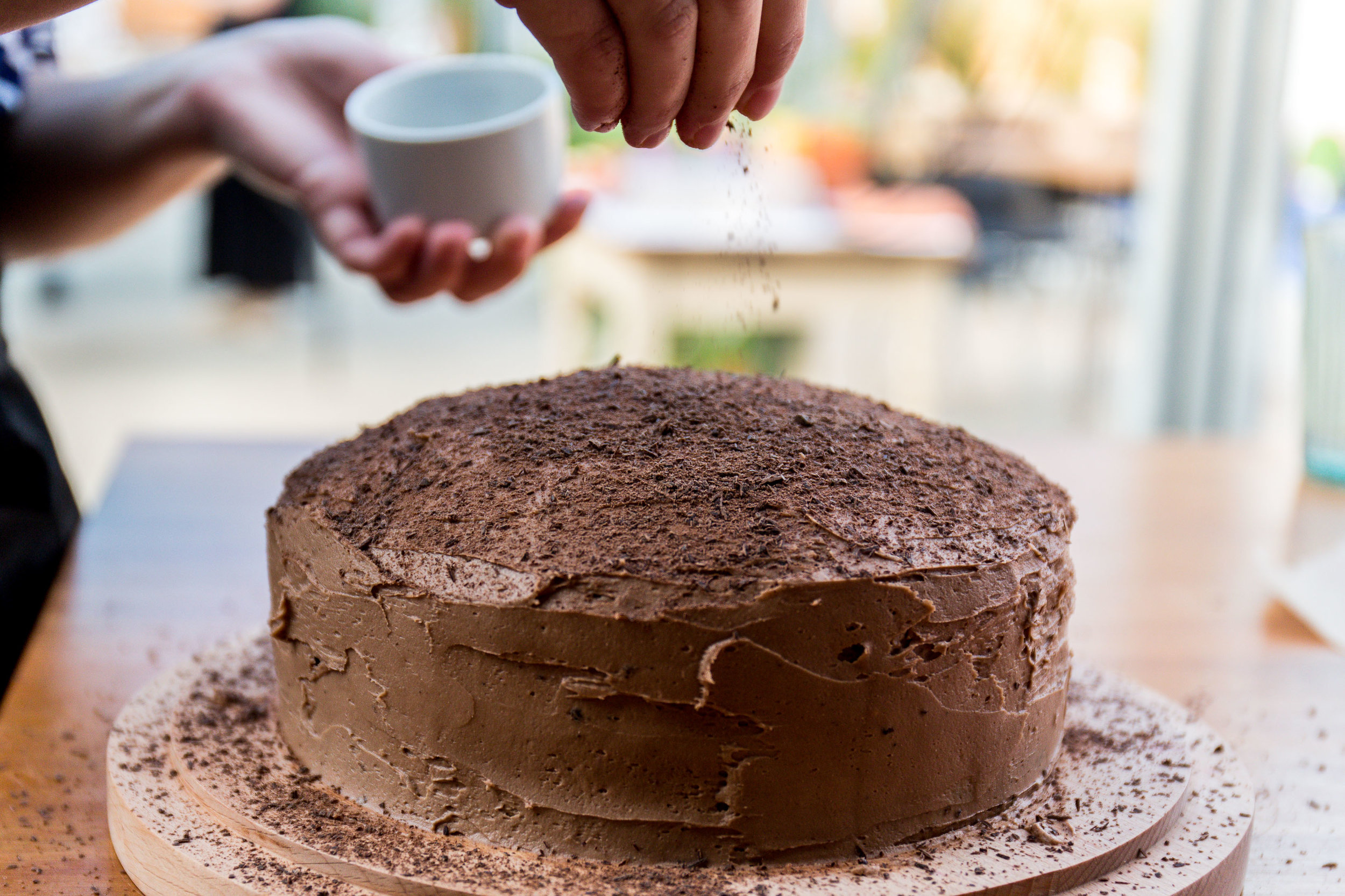 Sussex-mother-decorating-chocolate-cake.jpg