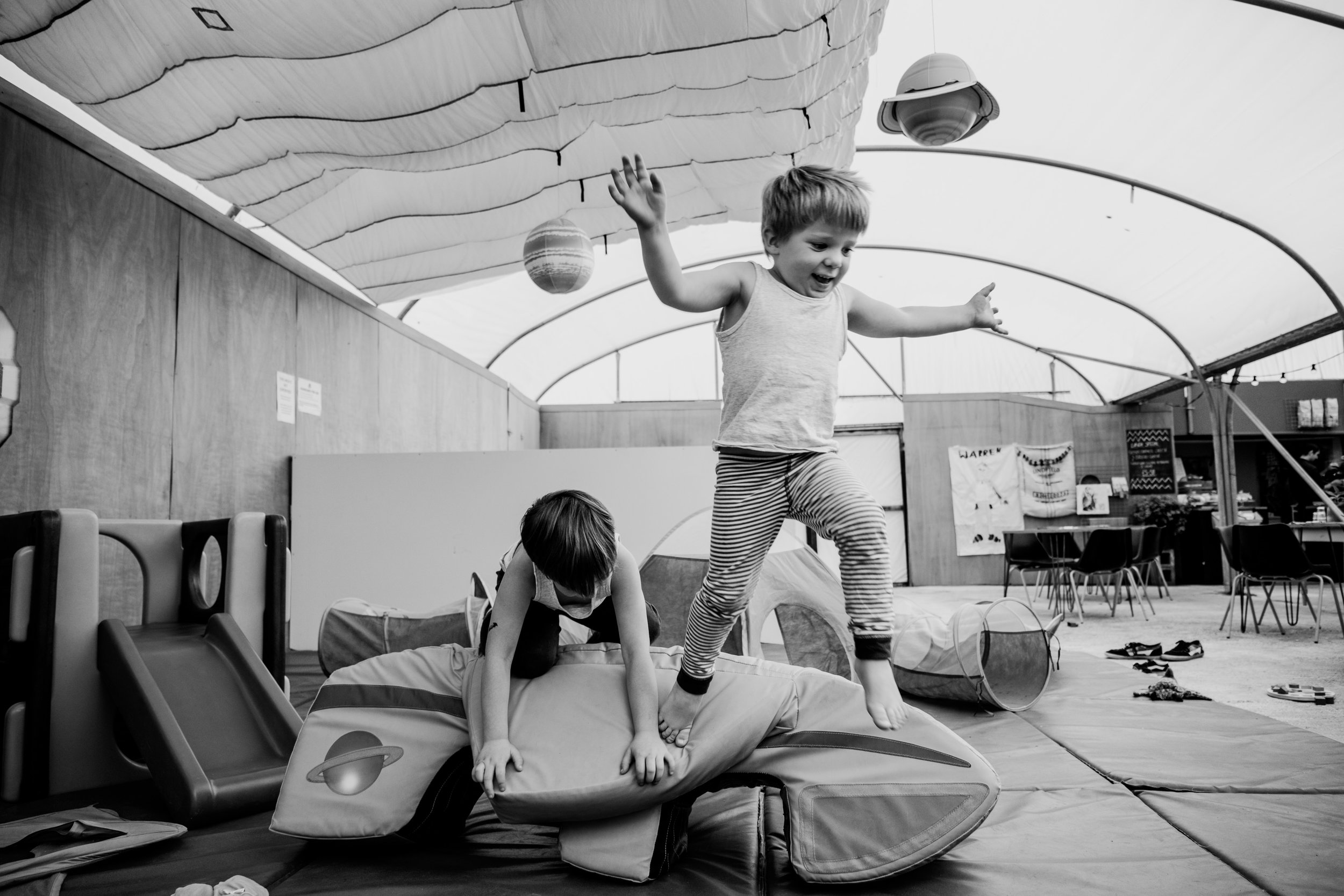 Sussex-mother-kids-jumping-in-play-area.jpg