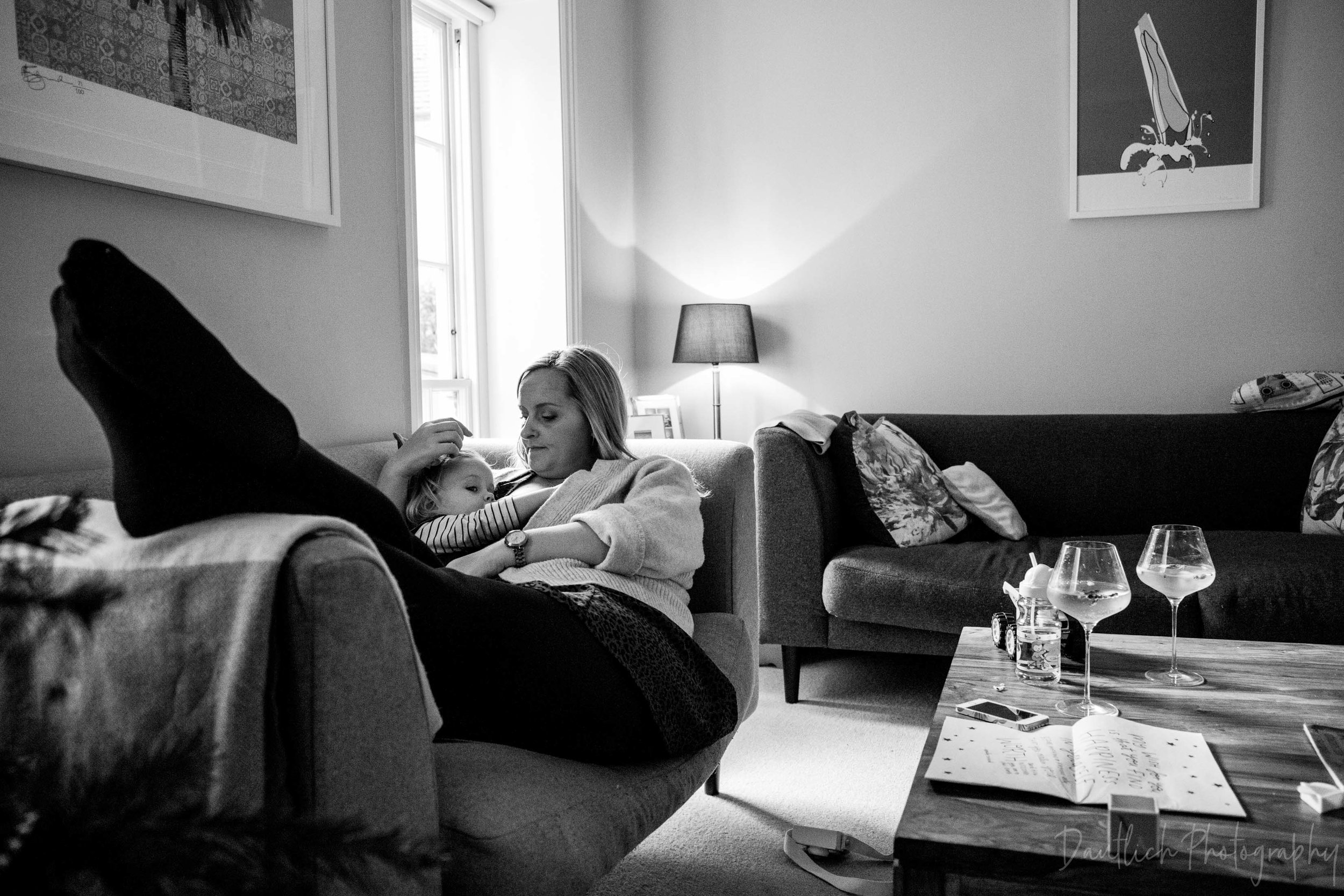 Lewis-family-photoshoot-mum-nursing-toddler-while-lounging.jpg