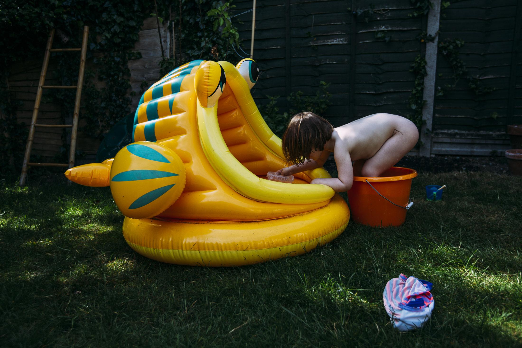 naked paddle pool family photography.jpg
