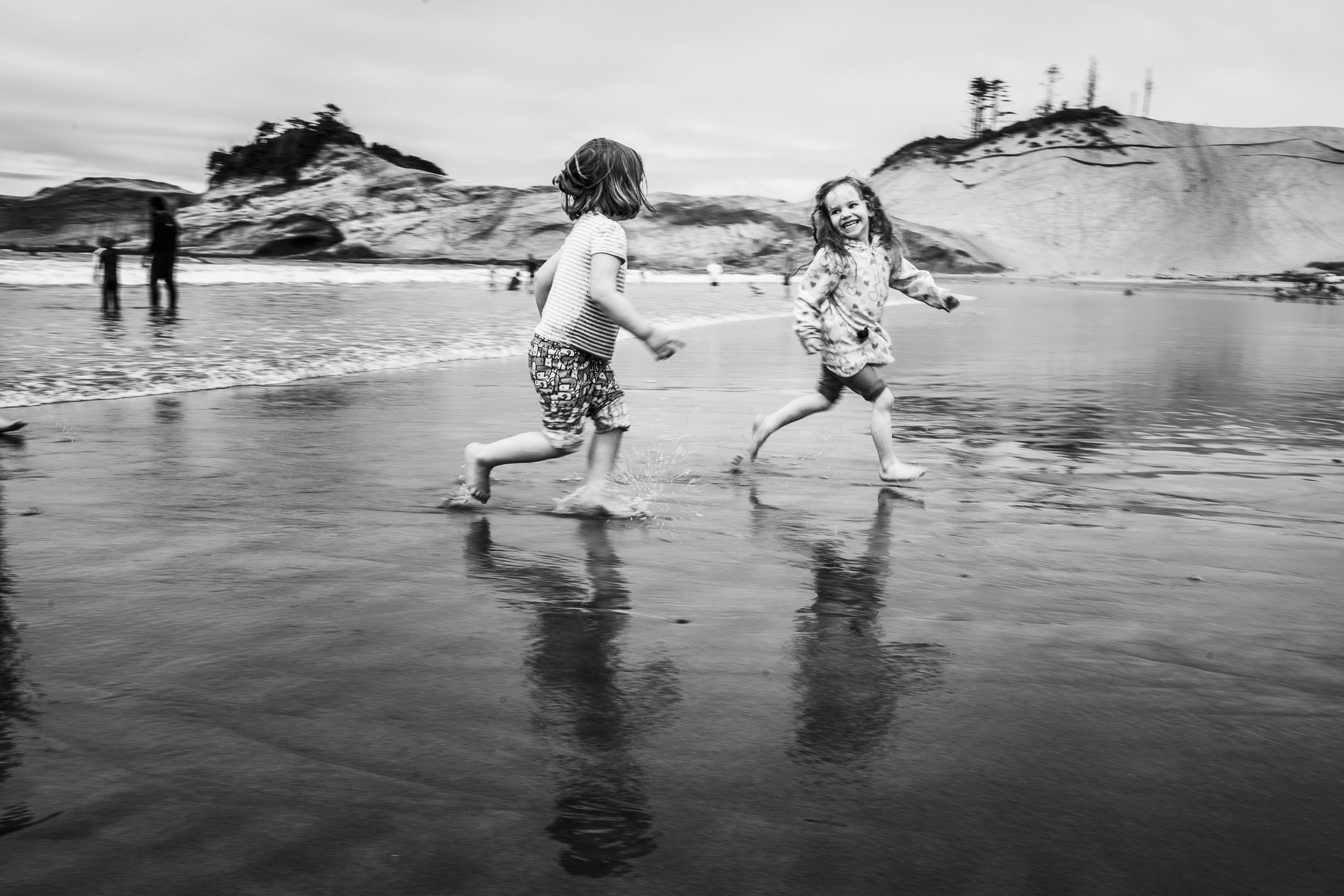 Toddlers running on the beach Cape Kiwanda
