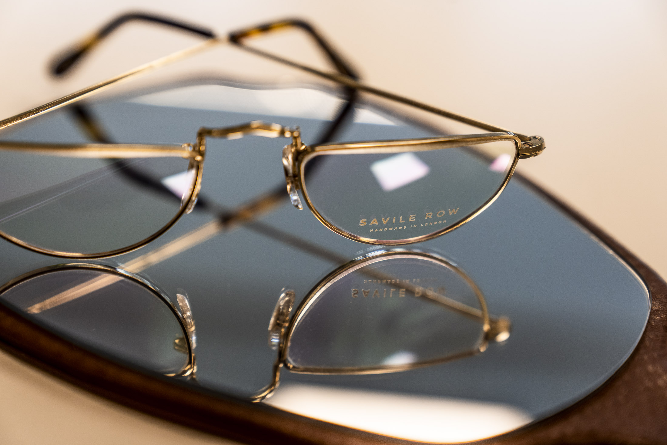 Commercial_photography_optometrist_glasses_on_mirror.jpg