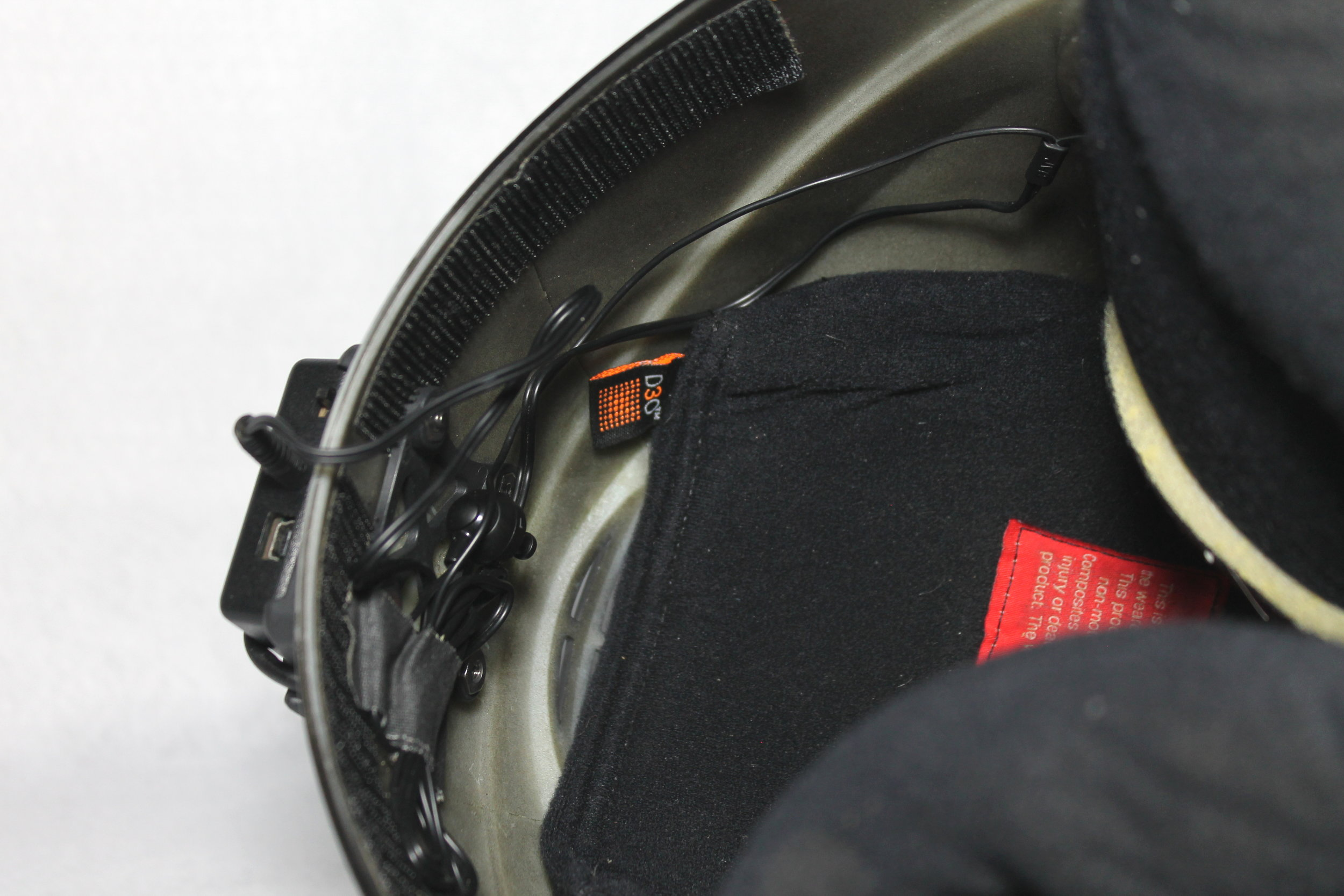 The padding is pulled back to show how the headphone is routed from the back of the helmet where the excess is secured to the hole in the padding on the right side of my helmet for the audible.