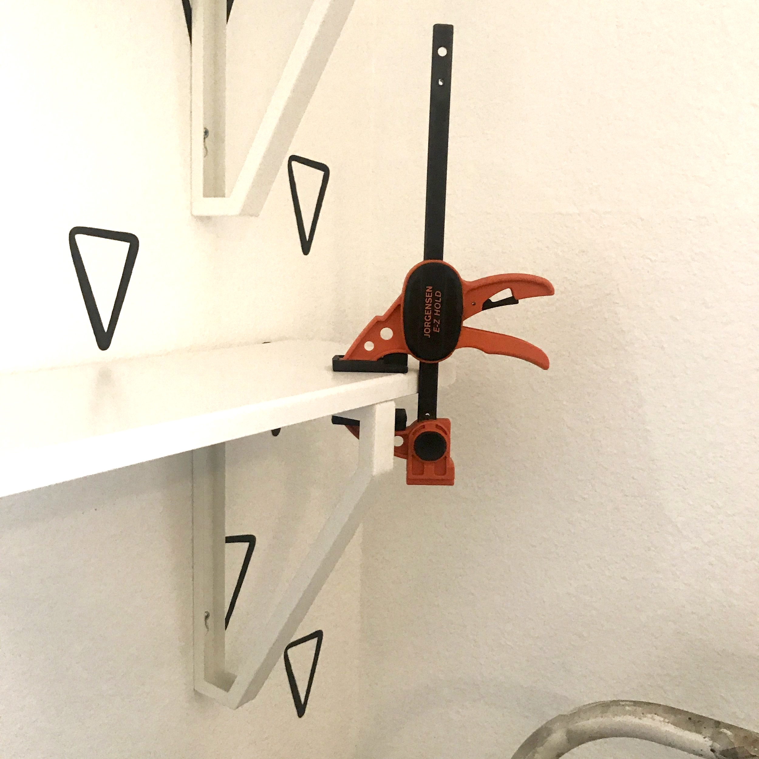 Using a clamp to hold them down while screwing them in. These  Pony | Jorgensen clamps  ROCK!!!