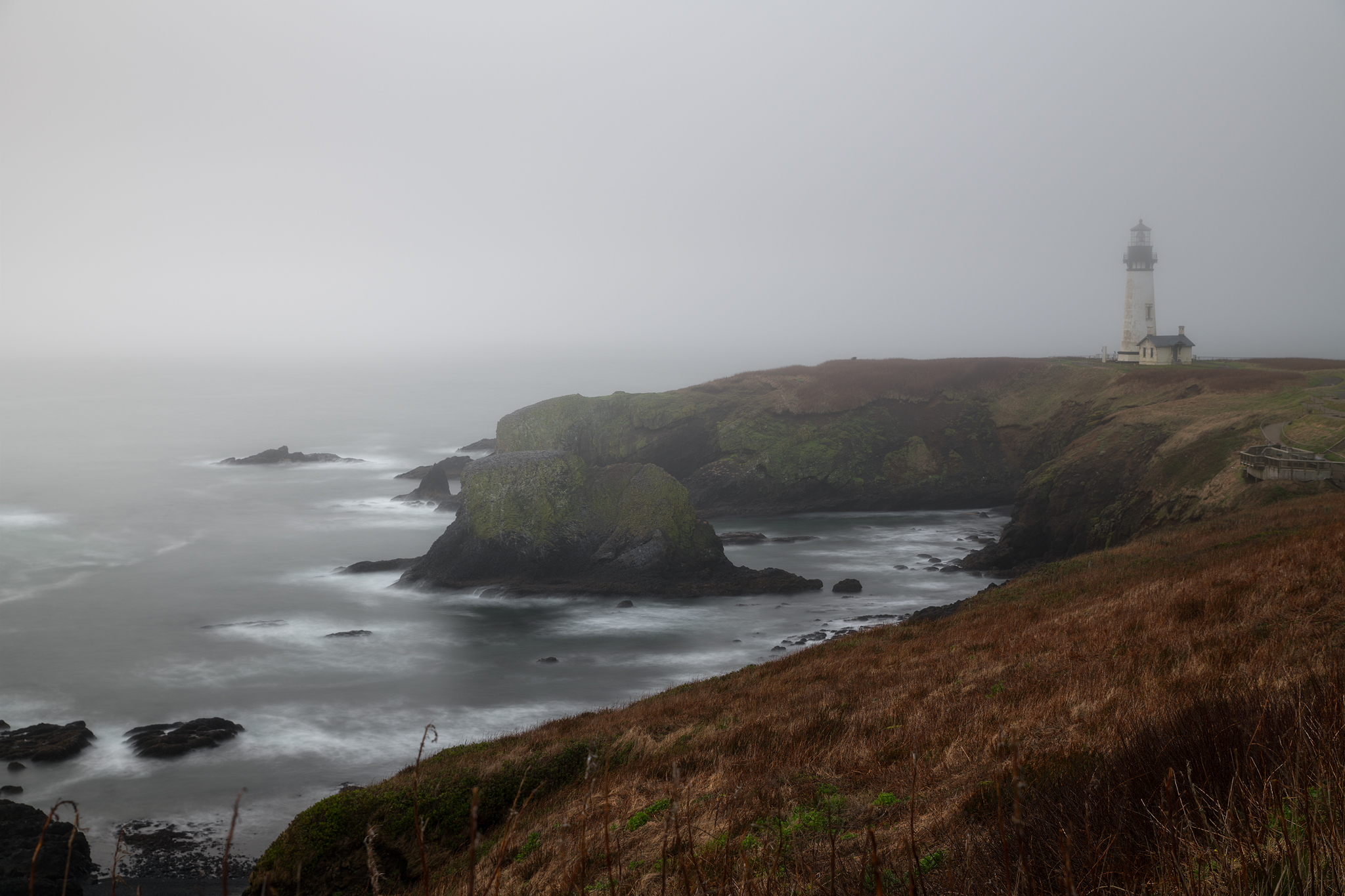 Yaquina Head Lighthouse during a foggy afternoon.