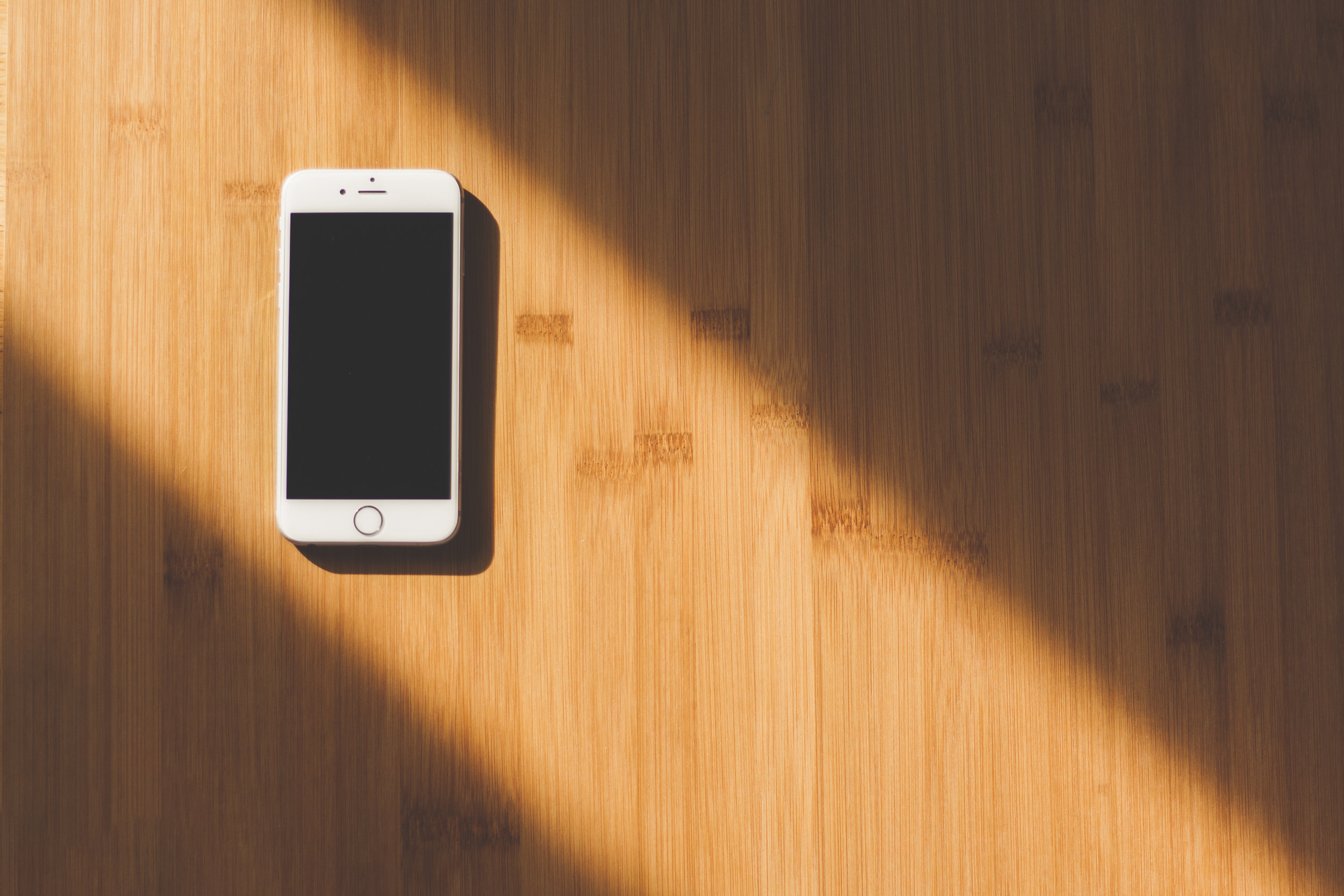 Smart Phone iphone 7 in light wood background