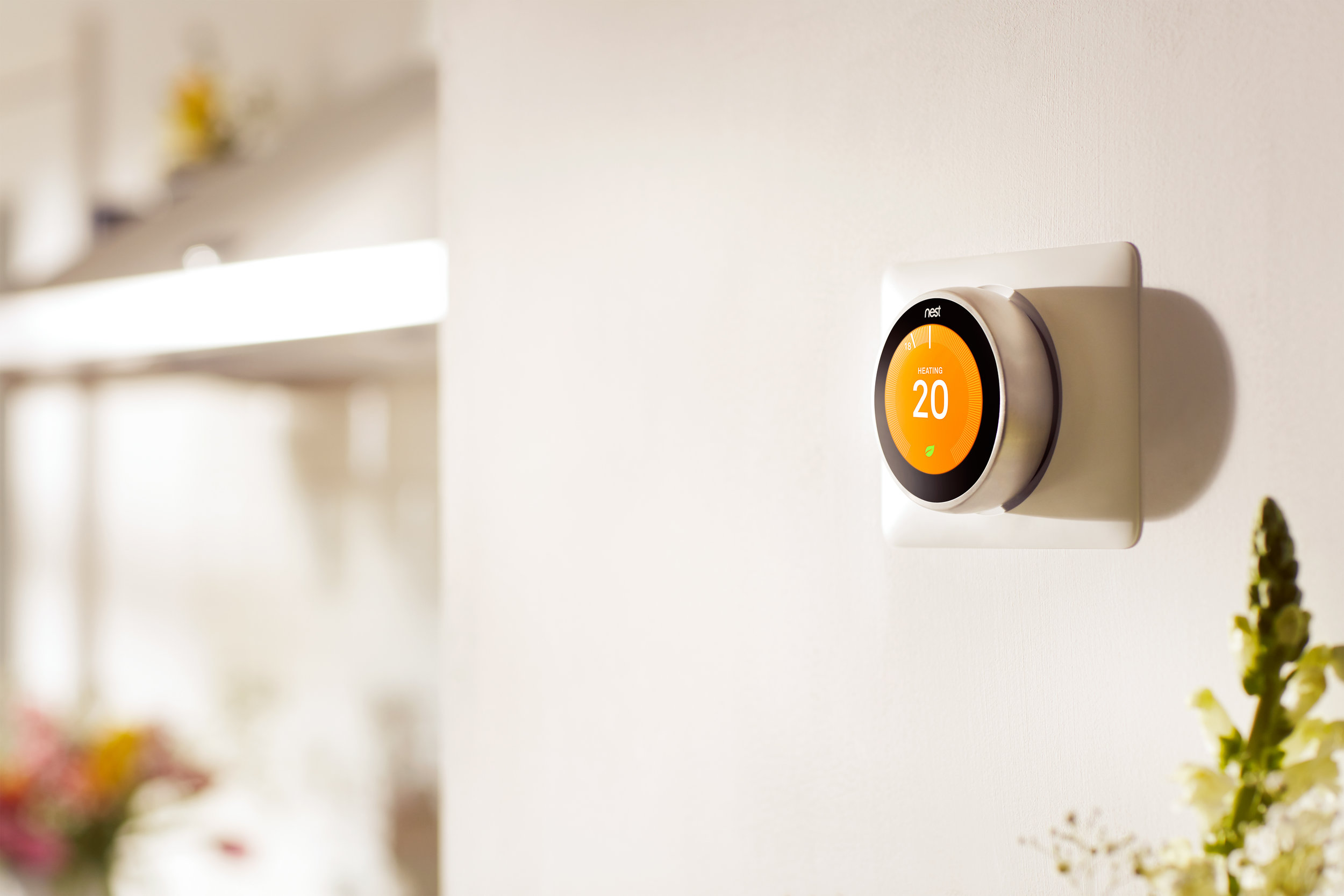 Smart Heating Control Nest thermostat kitchen wall orange display twenty degrees eco mode