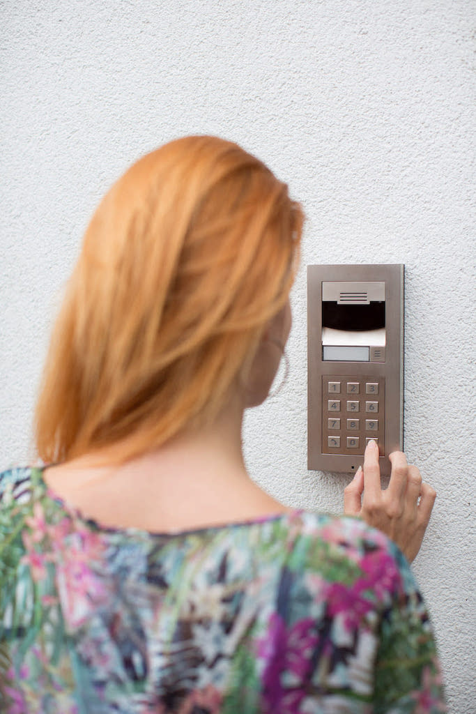 Smart_Home_Security_Control4_Video_Doorbell_Intercom_Anywhere_Red_Haired_Woman_pressing_keypad_brushed_Nickel