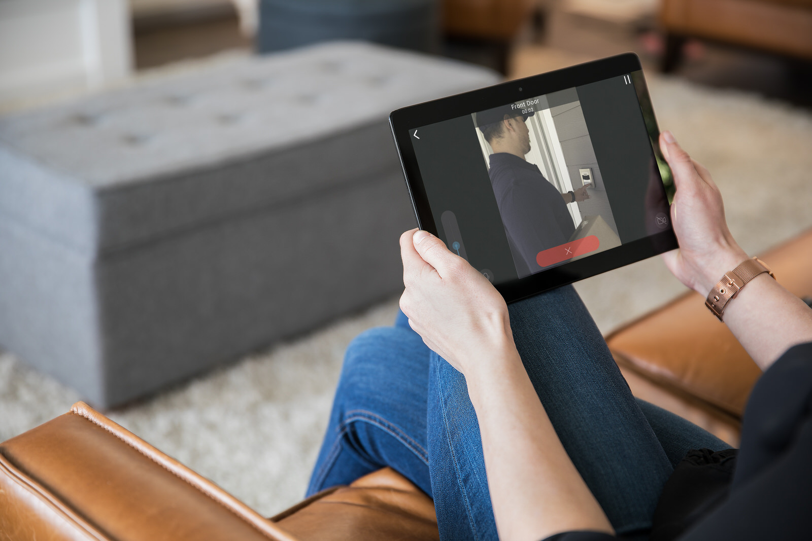 Video_Door_Bell_Entry_Man_Sitting_On_Brown_Leather_Sofa_Viewing_Front_Door_On_iPad