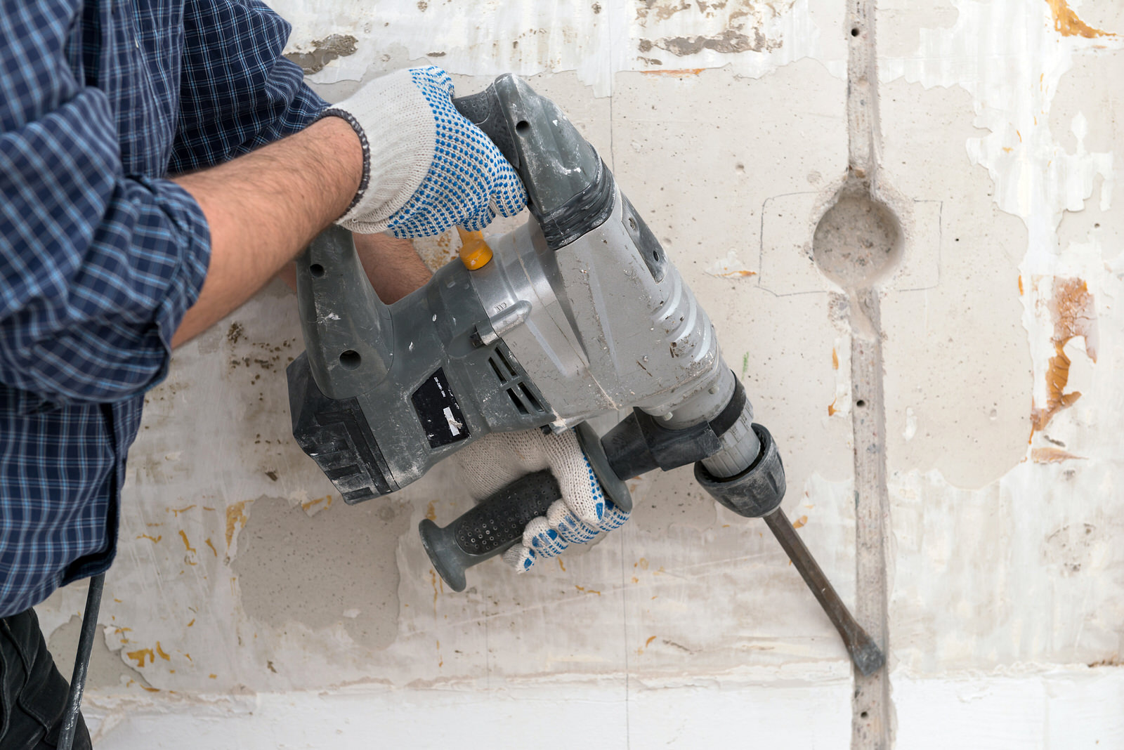 Video_Door_Bell_Entry_Man_Blue_Shirt_Jeans_Drilling_Cutting_into_concrete_wall_For_Electrical_Cable