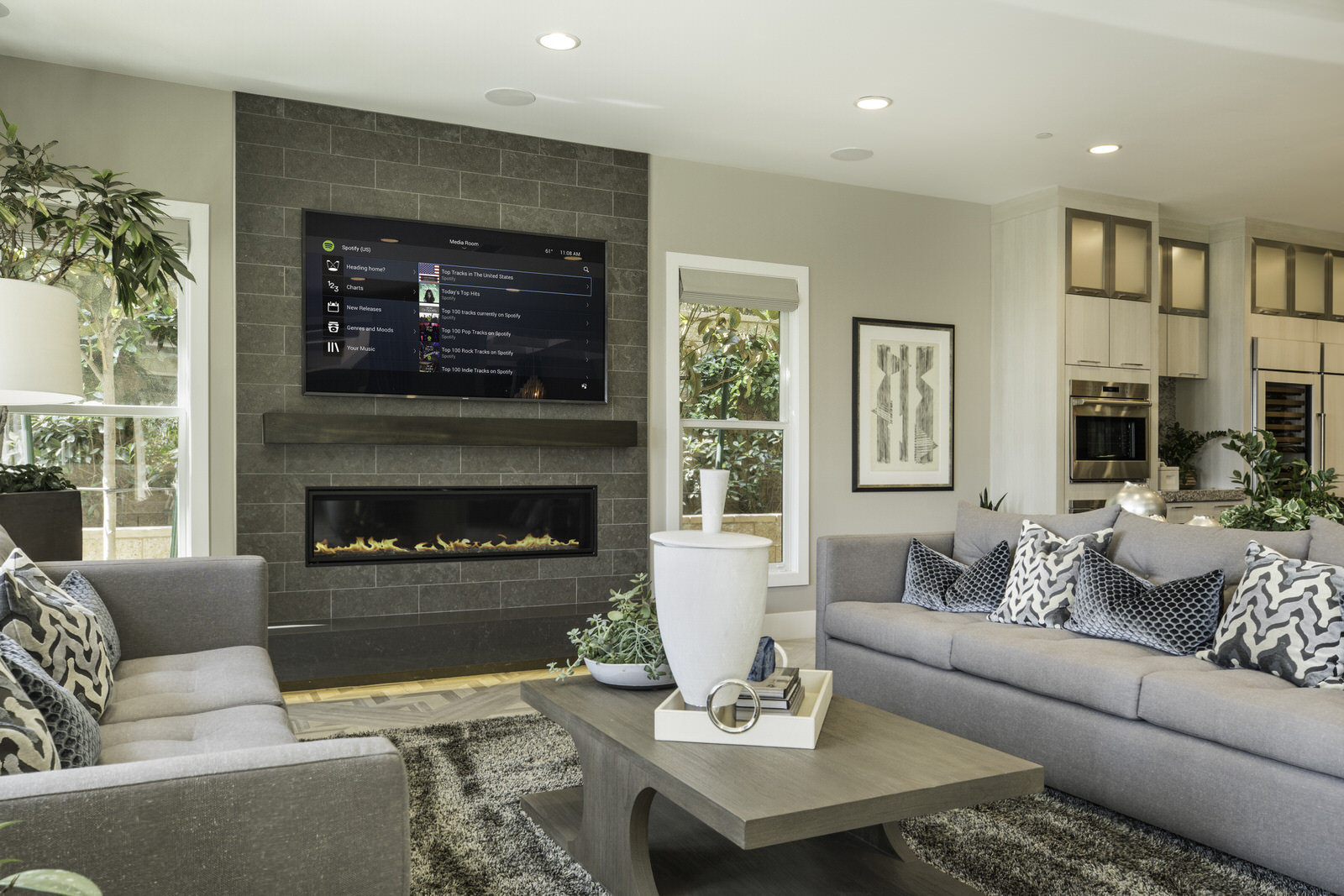 Control4_Home_Automation_Living_Room_Modern_Navigator_Grey_Sofas_Charcoal_Tiled_Wall_Brown_Wooden_Floor_Contemporary