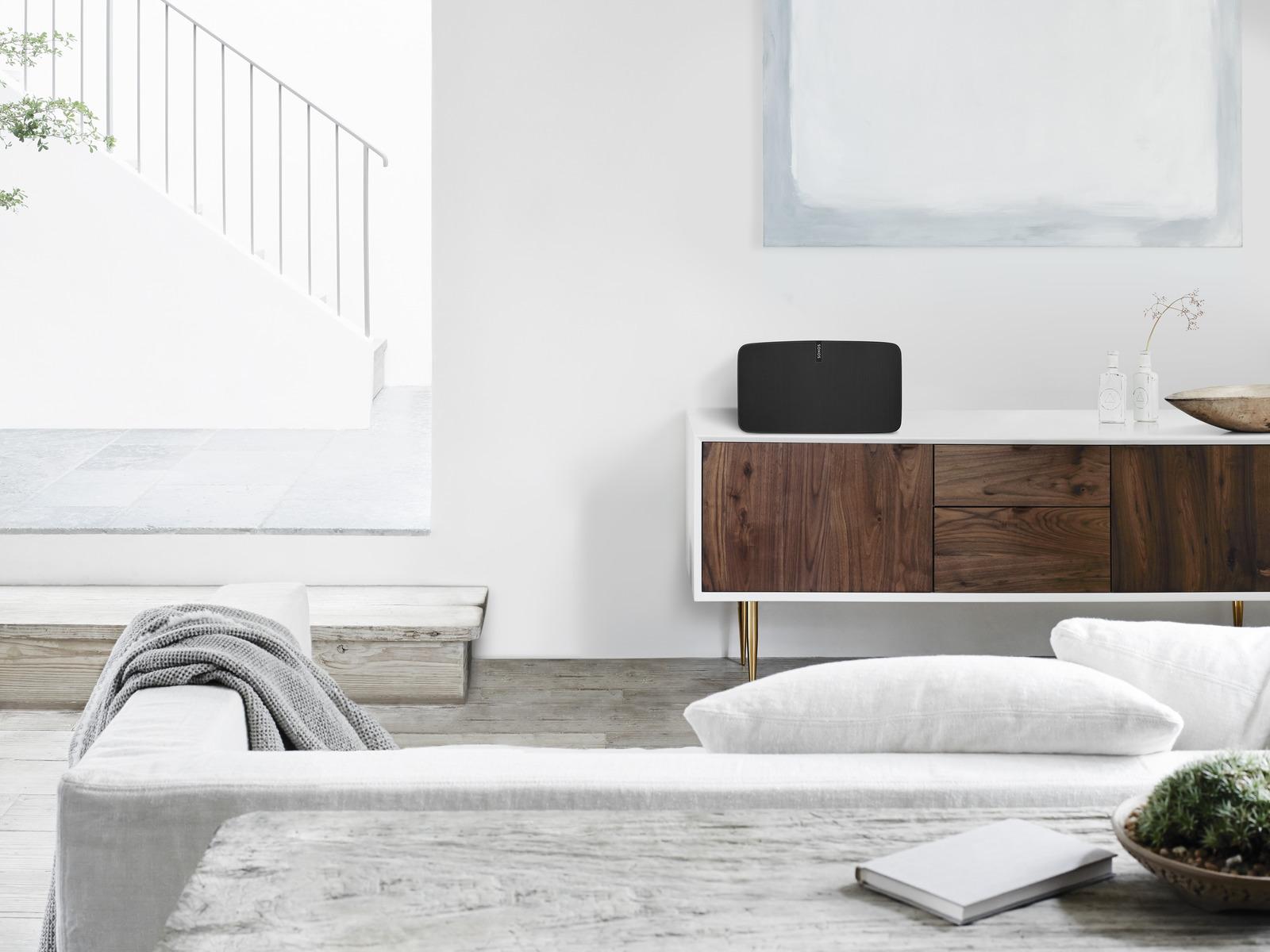 Multi_Room_Audio_Sonos_speaker_scandanavian_style_living_room_White_Walls_Floor_Grey_Sofa