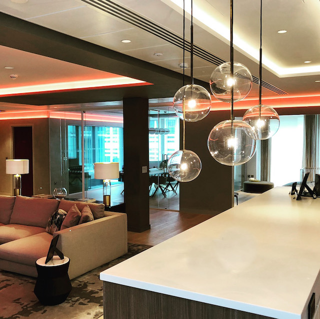 Lutron_Lighting_Experience_Centre_Modern_Pendant_Lamps_Red_LED_Strips_White_Countertop