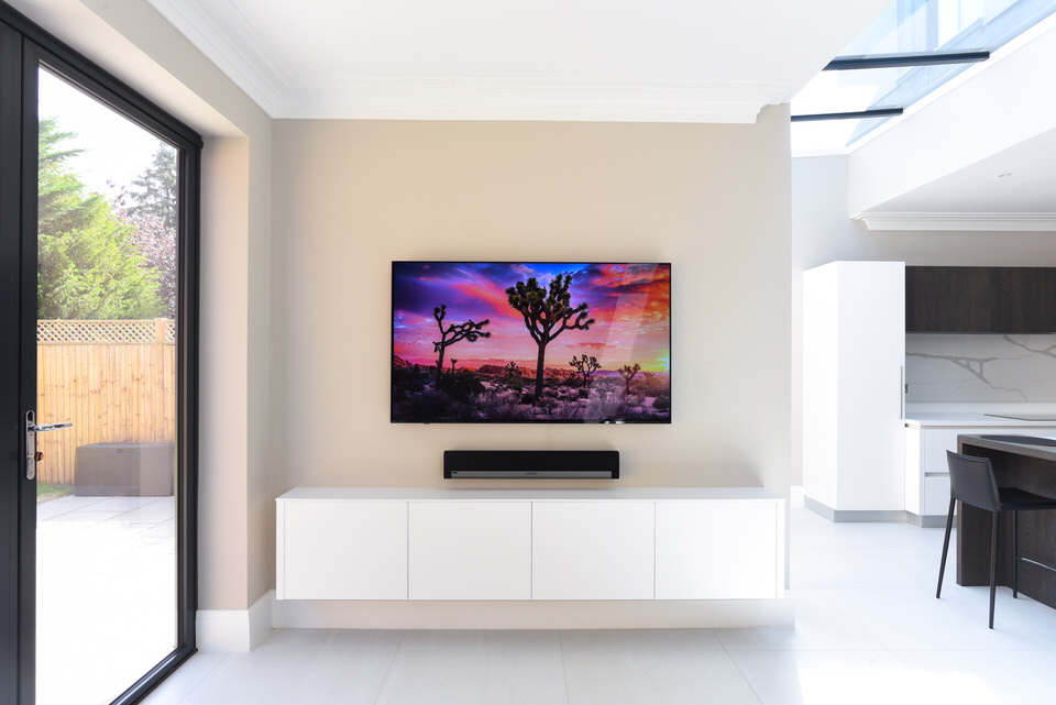 Weston_Avenue_Wall_Mounted_Sony_Television_Sonos_Playbar_Mojave_Desert_White_Cabinetry_White_Flooring