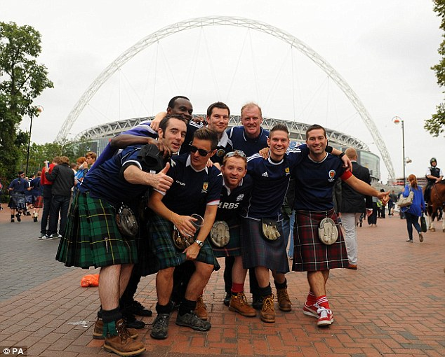 Fans of the Tartan Army supporting their team.