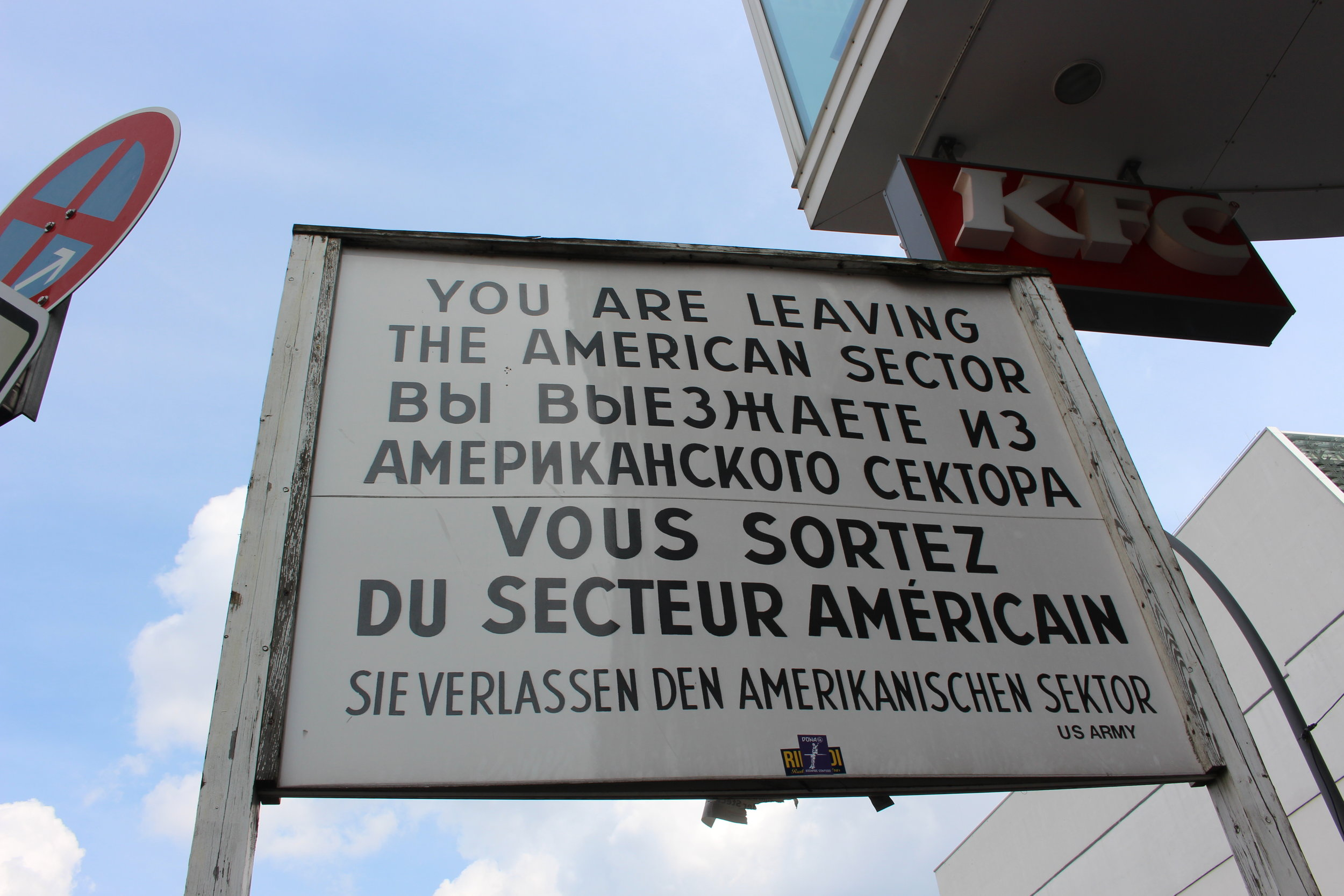 This is the sign that appeared at the crossing between East and West Berlin. The varied language shows the mixture of culture of the people who resided on each side of the wall.