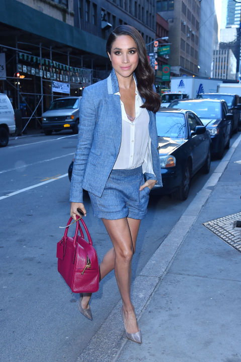 On her way to the Today Show, March 2016 wearing a blue jacket and pair of shorts with fushia margarita handbag, and silver pumps