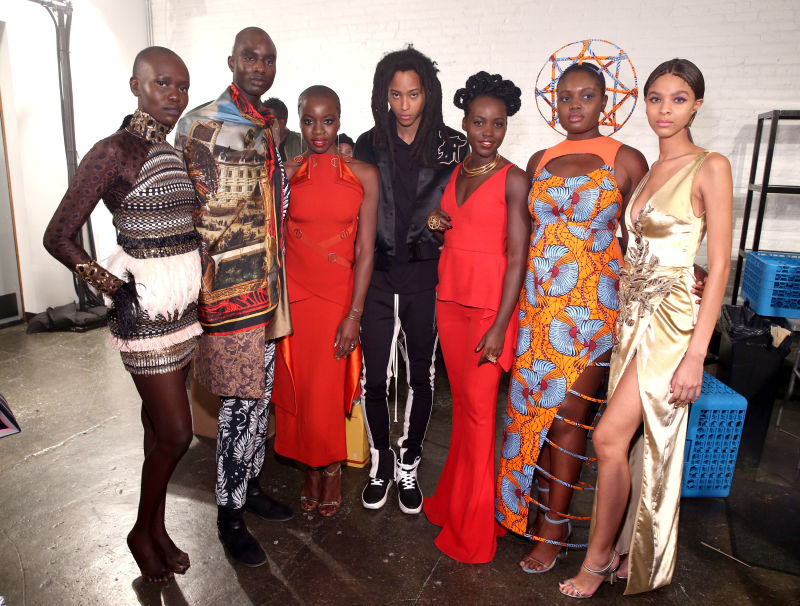 """Actors Danai Gurira (third from left) and Lupita Nyong'o (third from right) pose backstage with models during the  Black Panther  """"Welcome to Wakanda"""" New York Fashion Week Showcase on Feb. 12, 2018. Via Jemal Countess/Getty Images."""