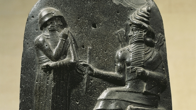 King Hammurabi receives the code of laws from the god Shamash.