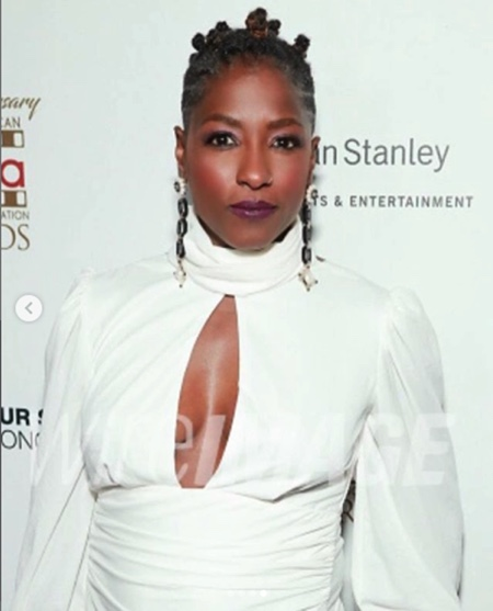 Rutina Wesley wearing the Tracee backless top in ivory.