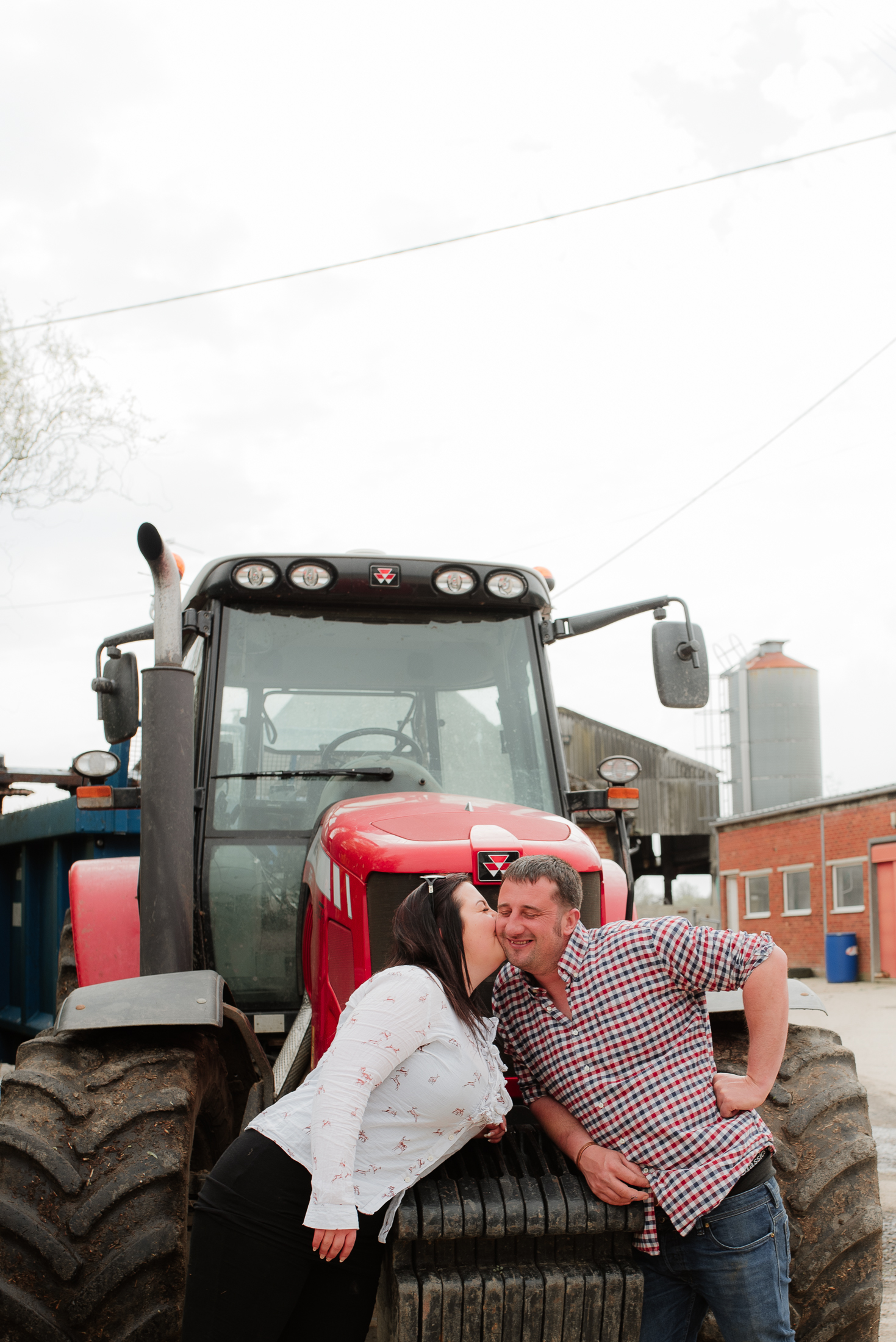 kissing in front of tractor