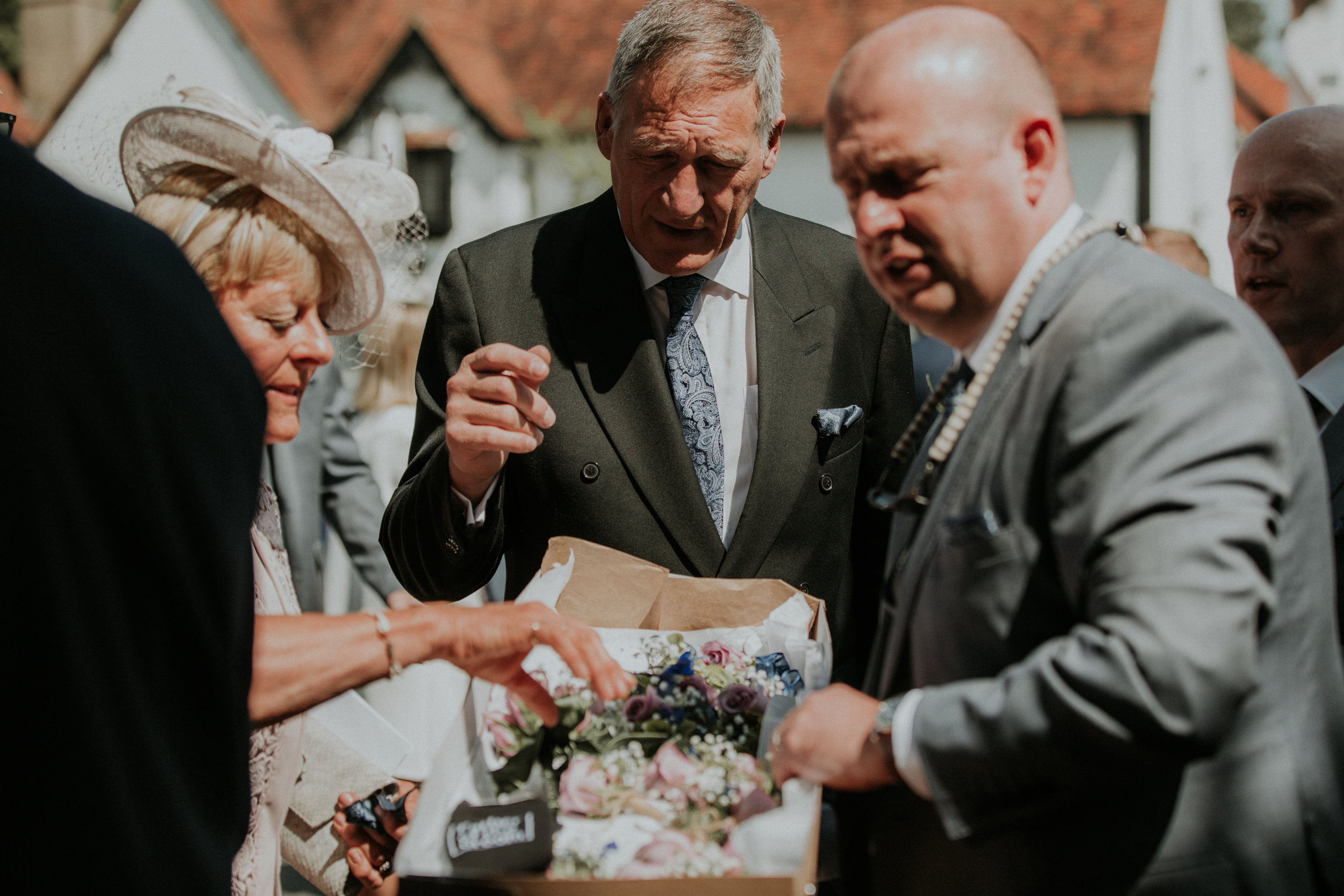 giving out buttonholes