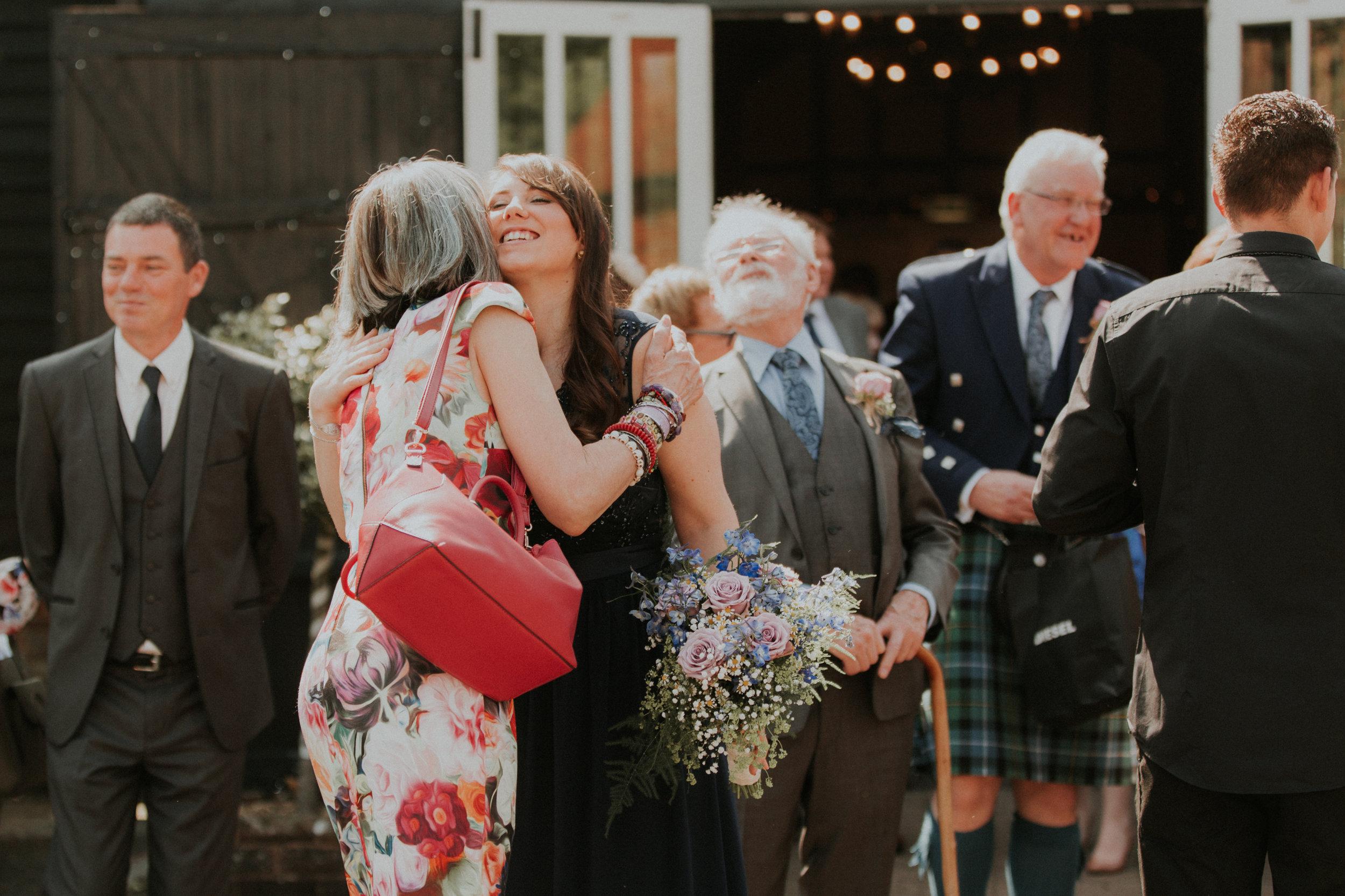 guests congratulating after wedding ceremony