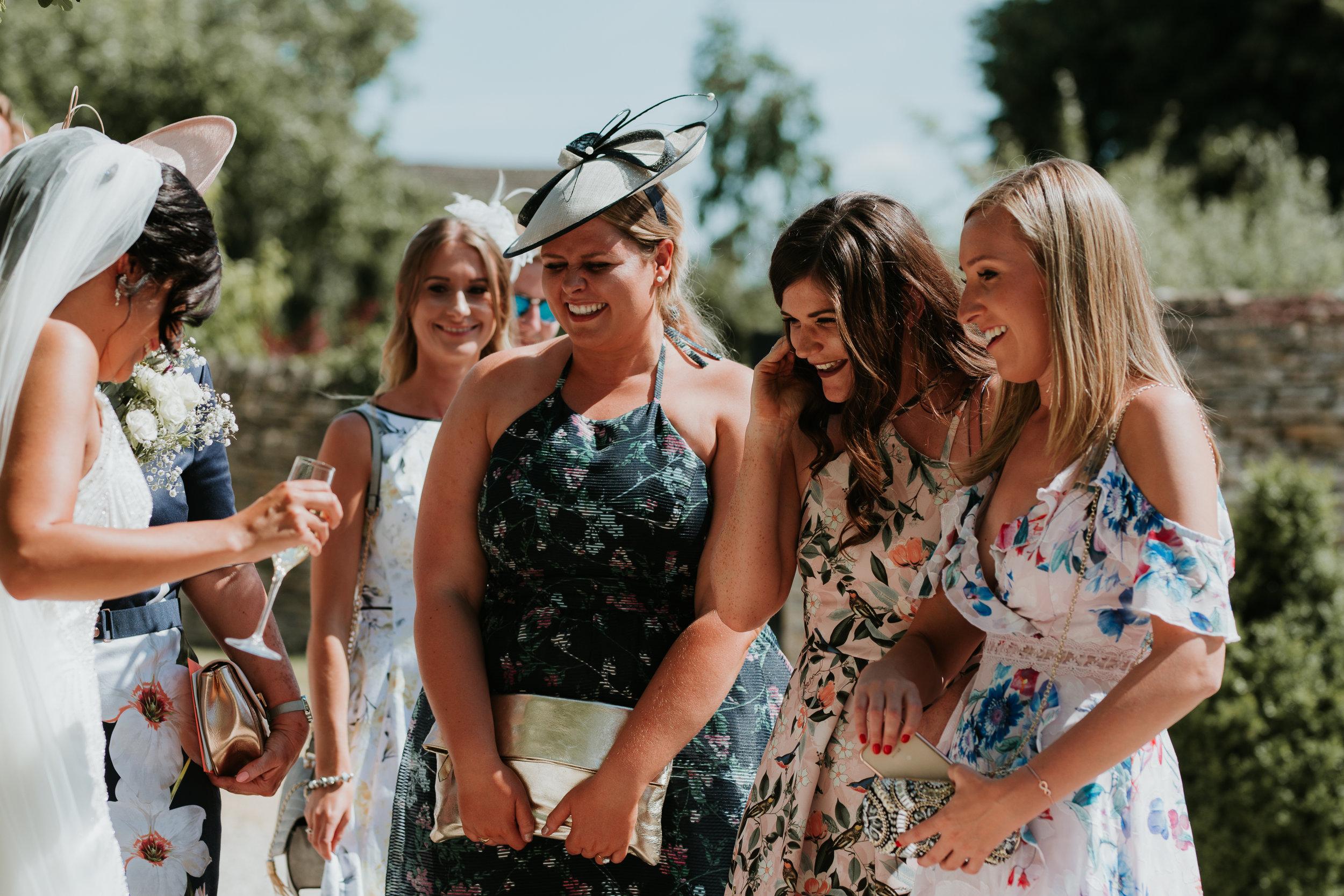 wedding guests smiling at Bride