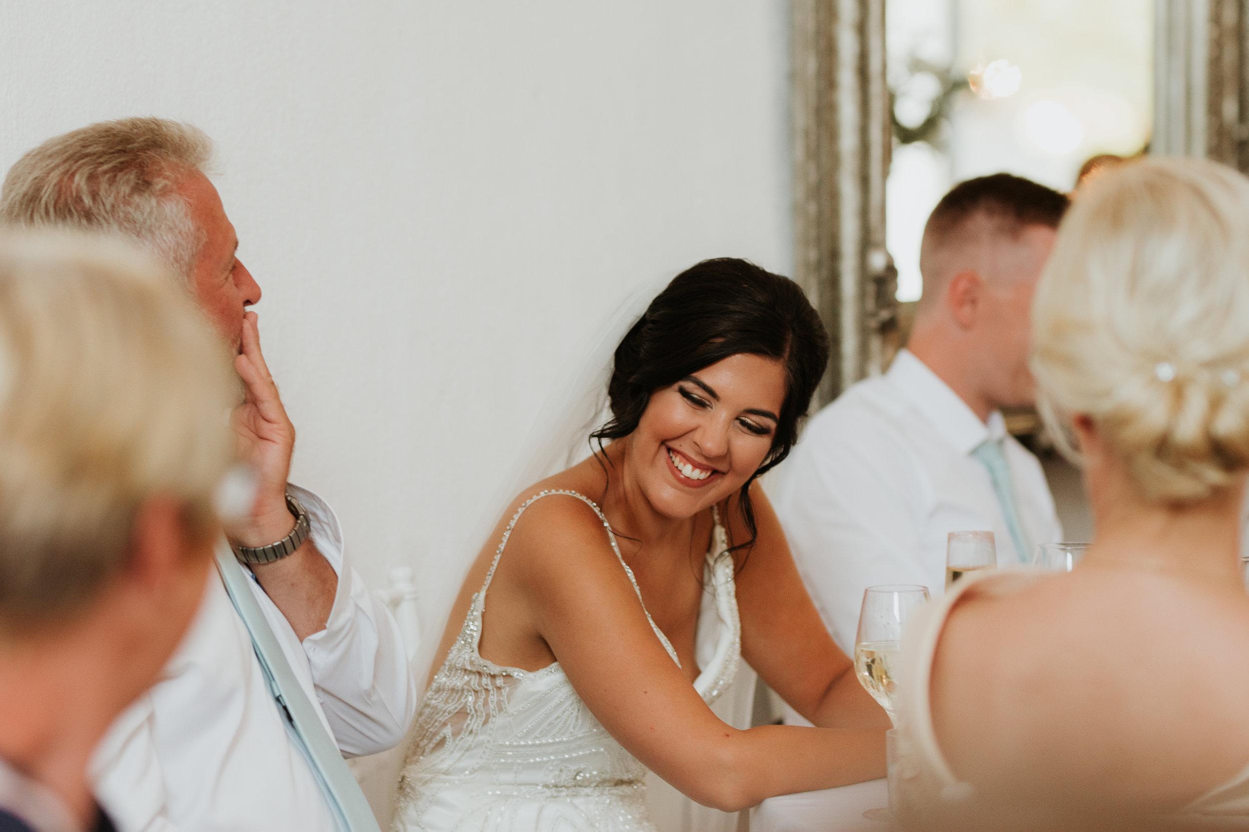 Bride laughing at Best man speech