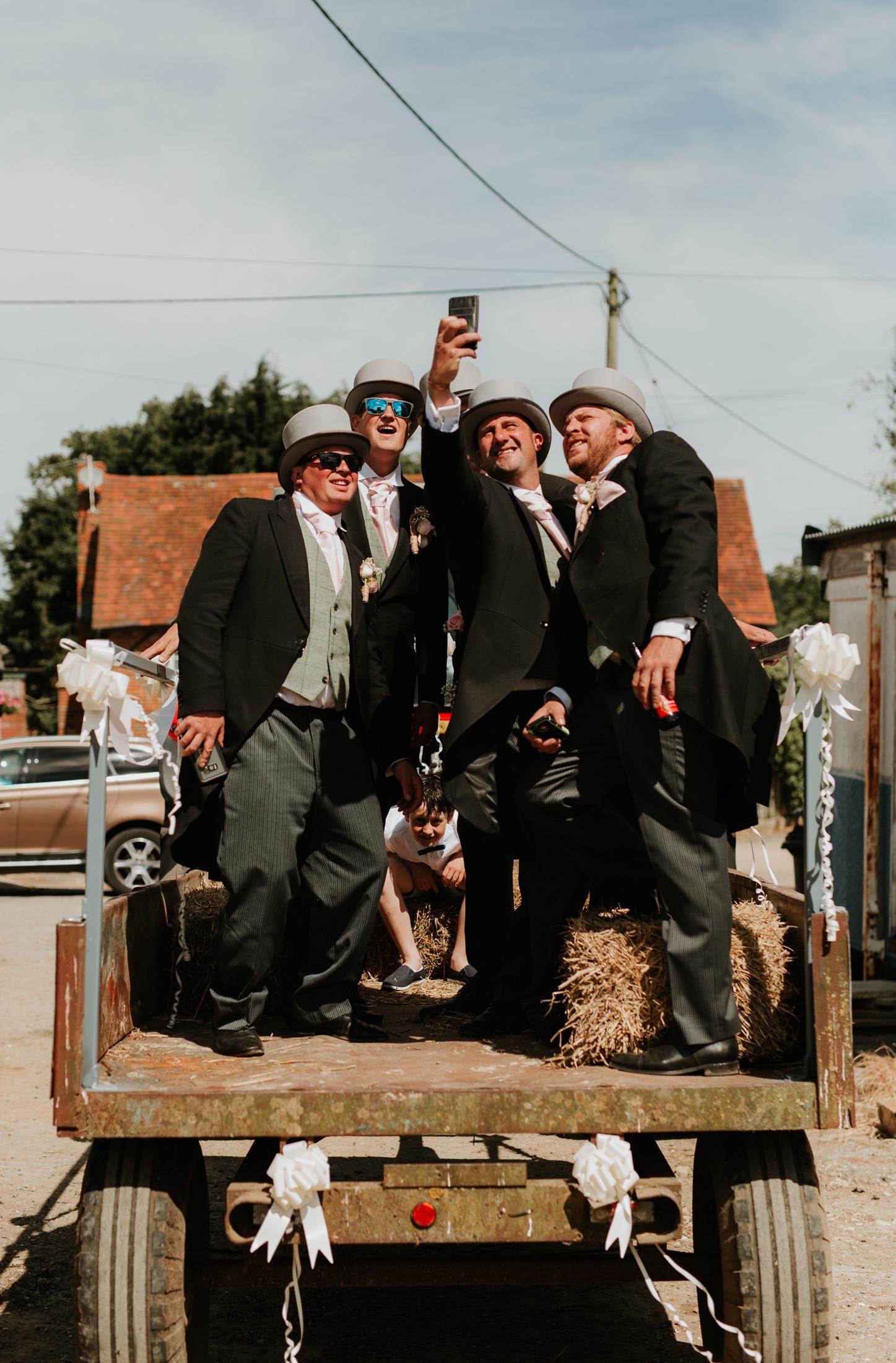 Groom selfie with ushers