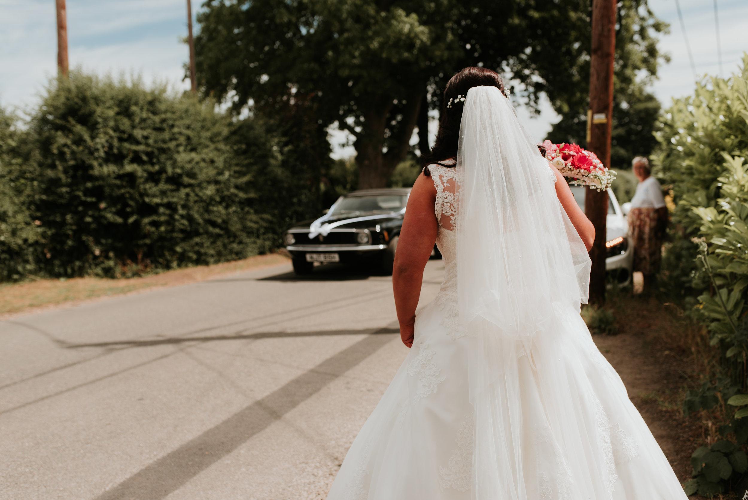 Bride waiting for wedding car