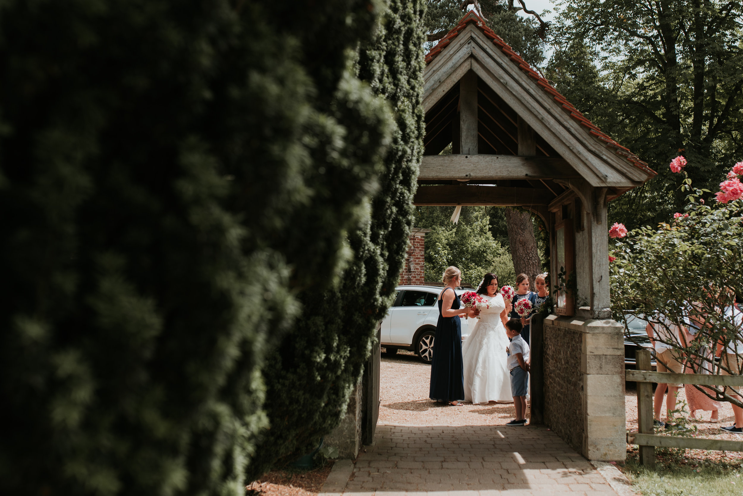Bride with Bridesmaids outside Church Wokingham