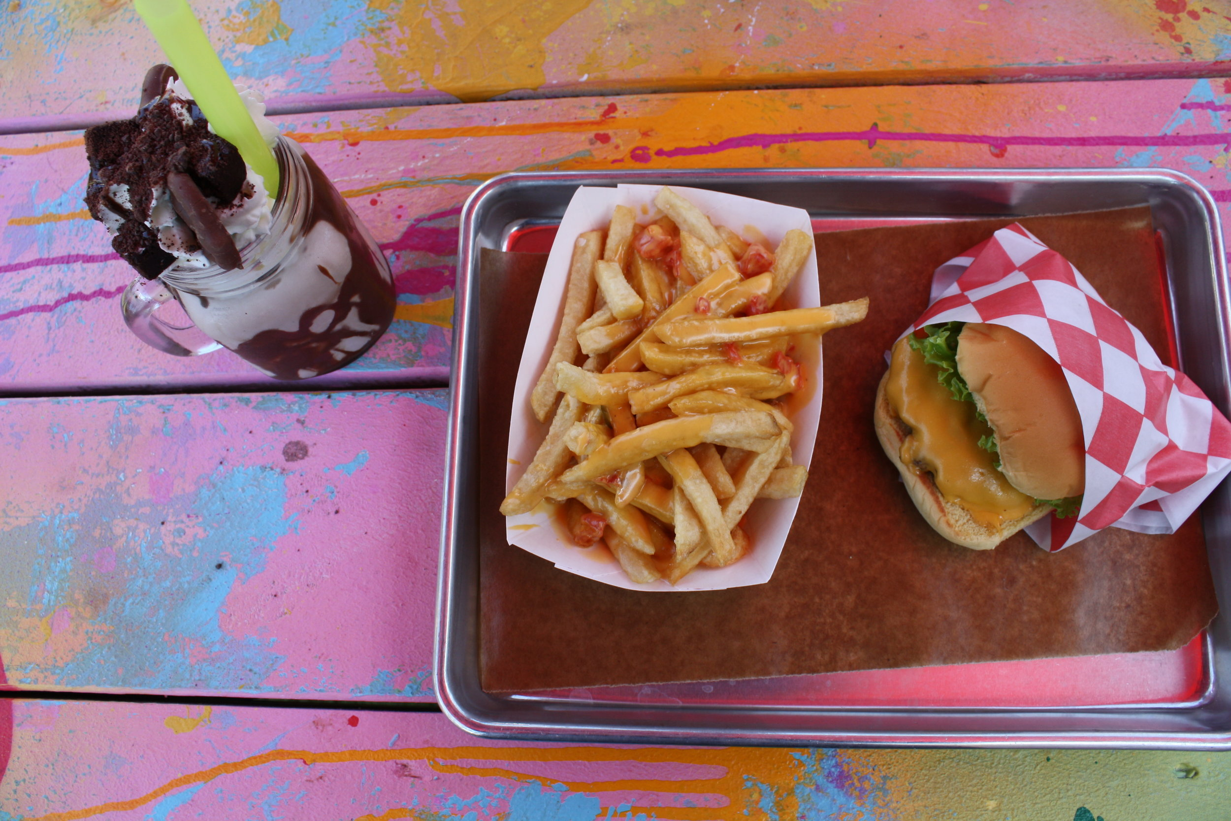 FM Burger, Fries with queso, and Chocolate shake