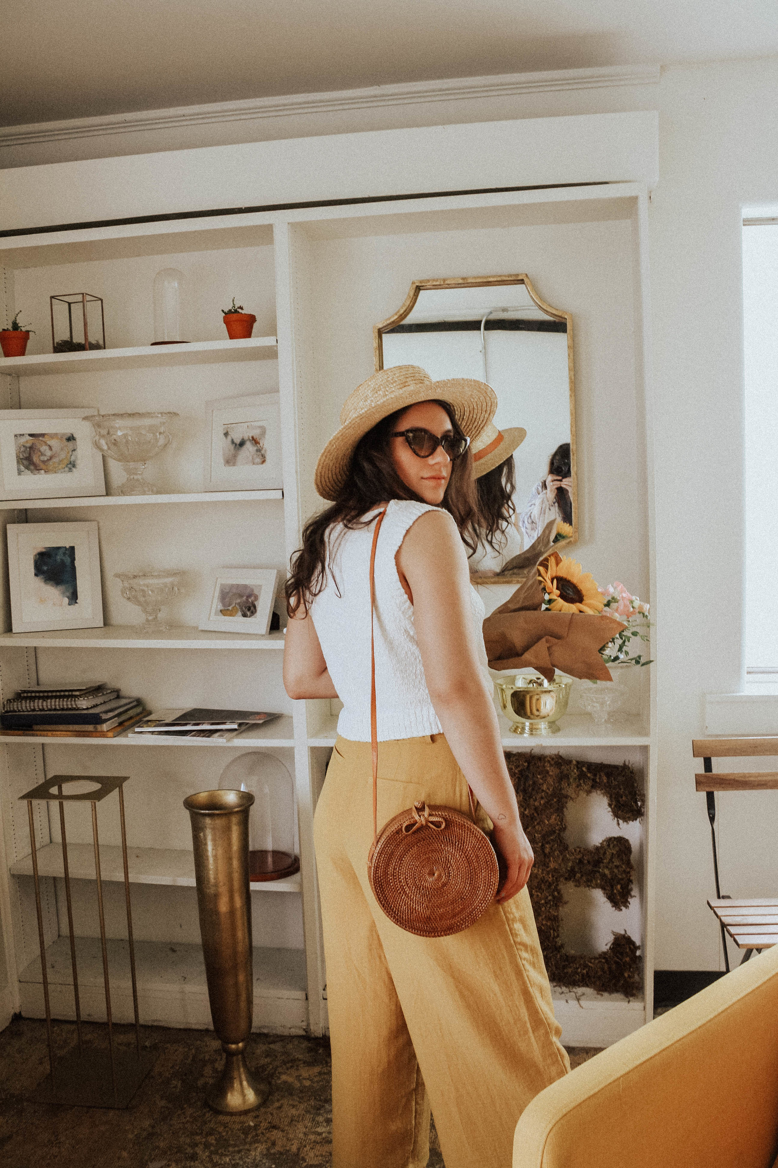 Hat: Lack of Colors; Sunglasses: Amuse Society X D'Blanc; Top: Moon River; Pants: Lost + Wander; Purse: Cleobella