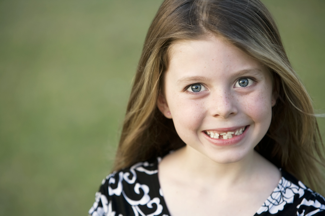 little girl with crooked teeth.jpg