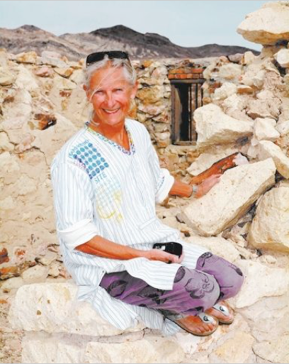 Richard Stephens/Special to PVT - Belgian artist Cecile Massart sits among the ruins of the Bullfrog jail behind the Red Barn Art Center at Rhyolite.