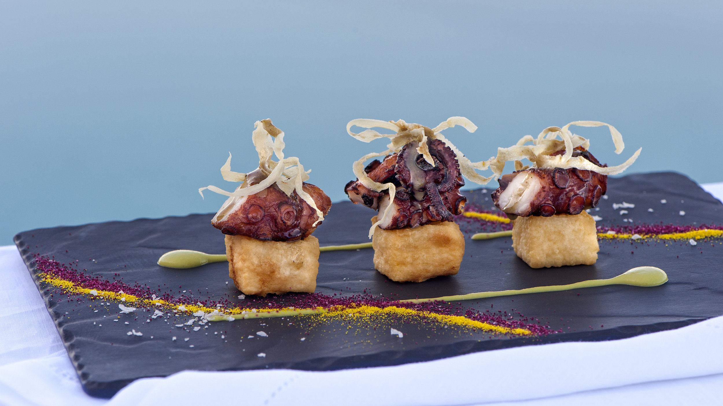 Grace Santorini - Seared octopus, spring pea purée, deep fried polenta & lime truffle honey dressing