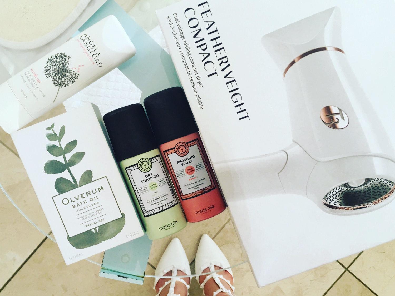 Bathroom essentials: Angela Langford  exfoliator, Olverum bath oil, Maria Nila hair products, T3 Haircare UK travel hair dryer